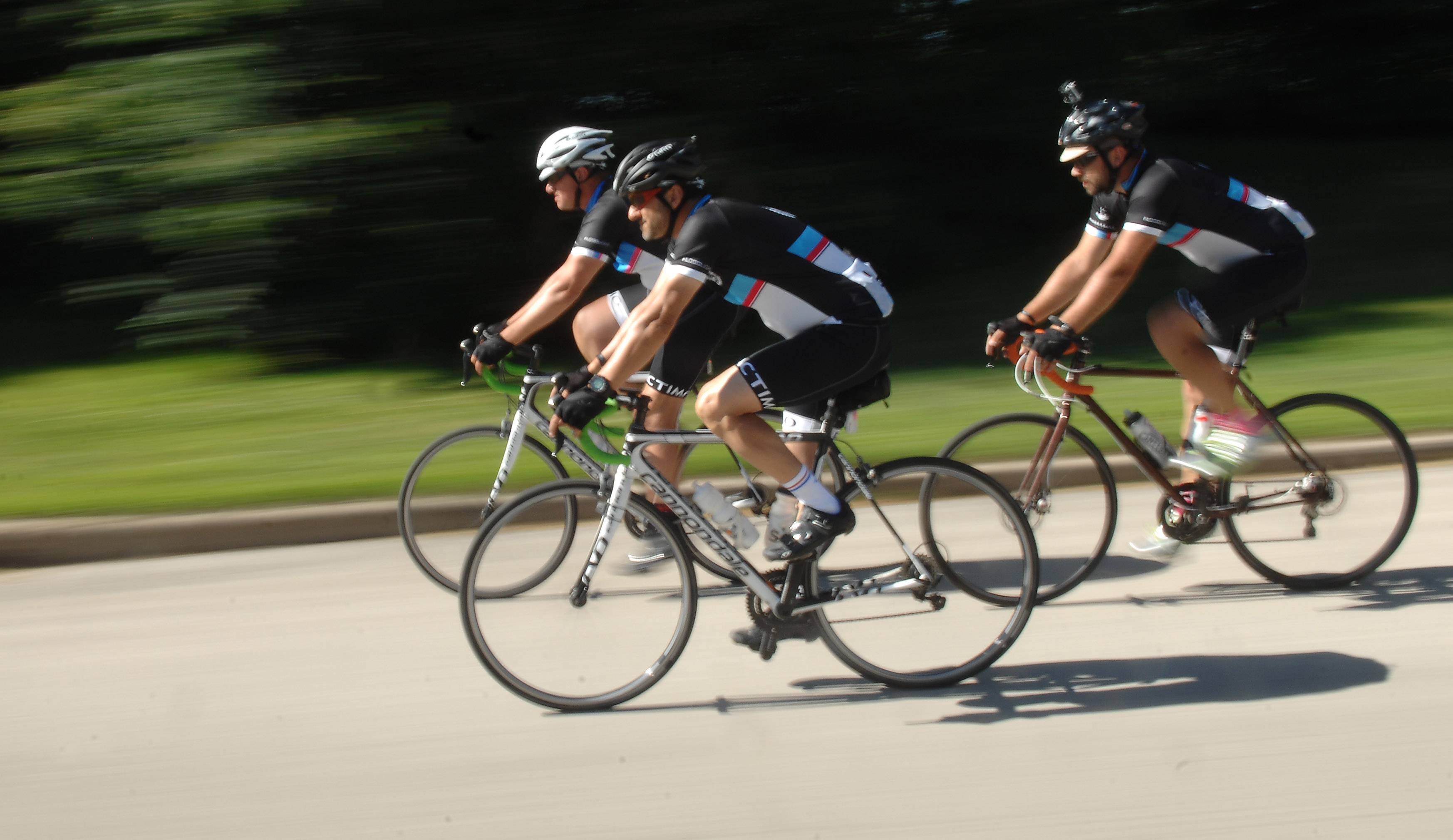 Justin Ahrens, left, Ryan Connary and Brian MacDonald recently pedal the last few miles of their 1,207-mile journey from Boston to Chicago.