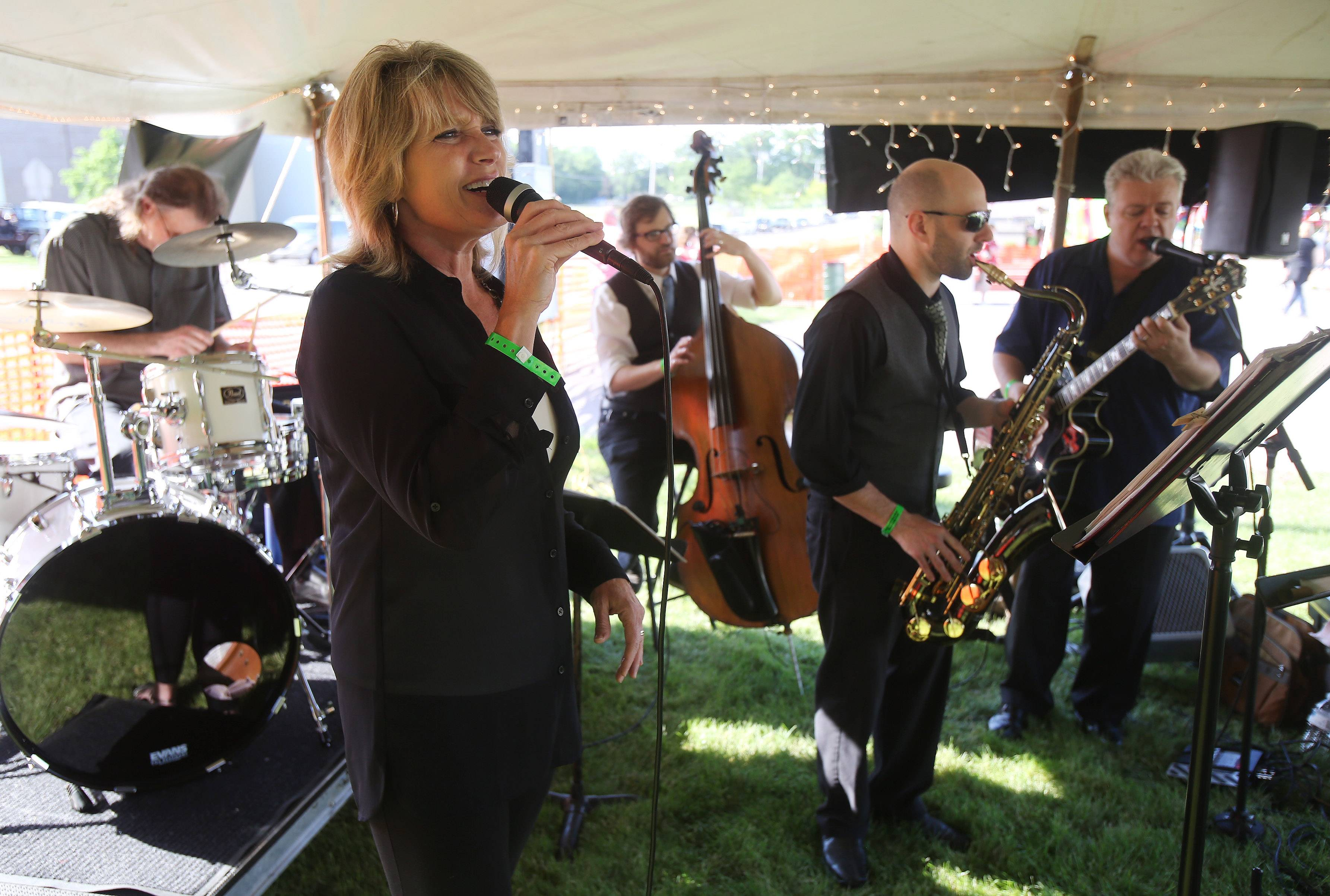 Beth Ruehrdanz sings with the SwingSets jazz band in the wine and cheese tasting tent.