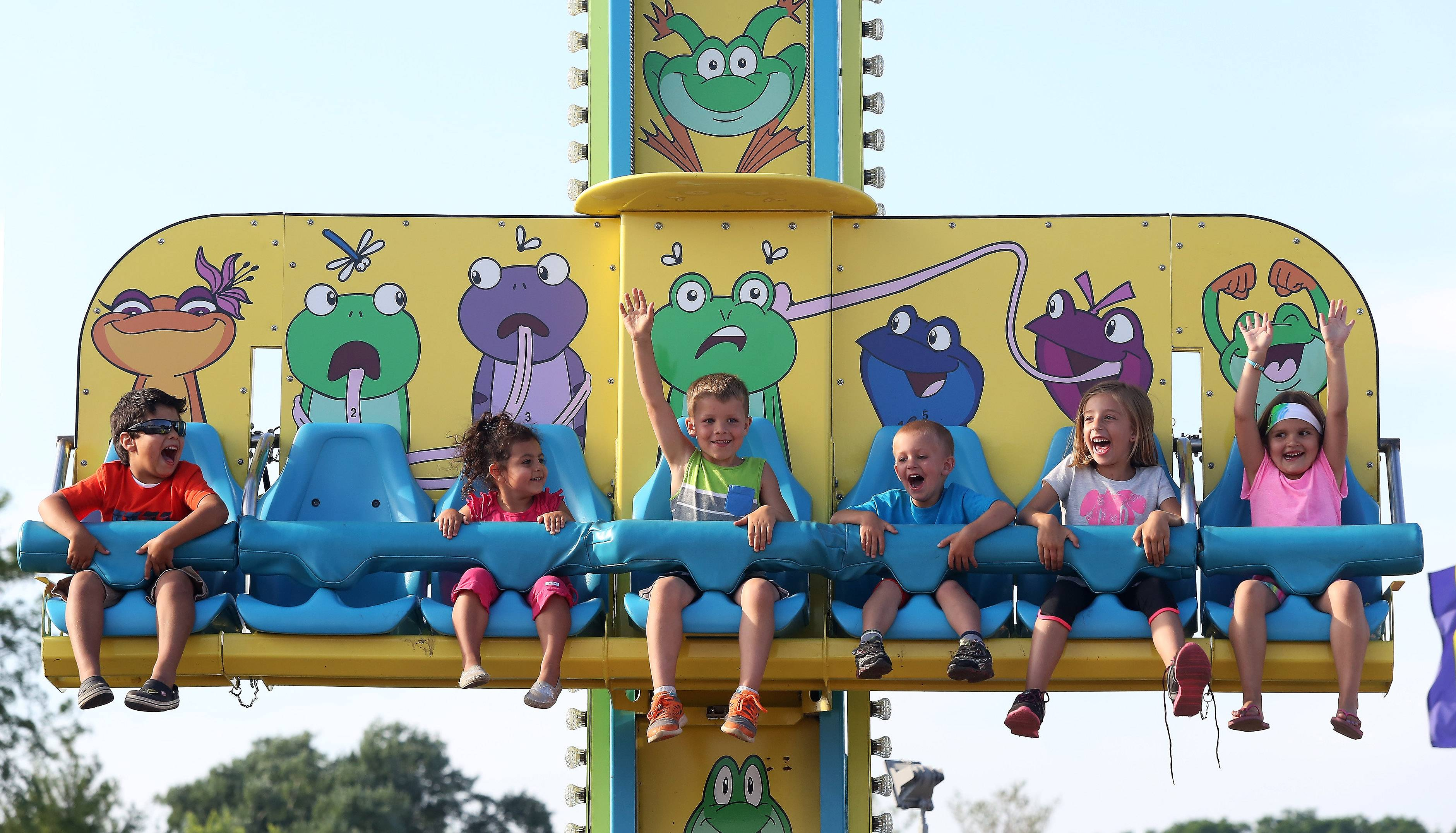 Children have fun on the Frog Hopper ride during the first day of the 35th annual Wauconda Fest at Cook Park on Thursday. The festival featured carnival rides, food tent, wine and cheese tasting, and musical entertainment.