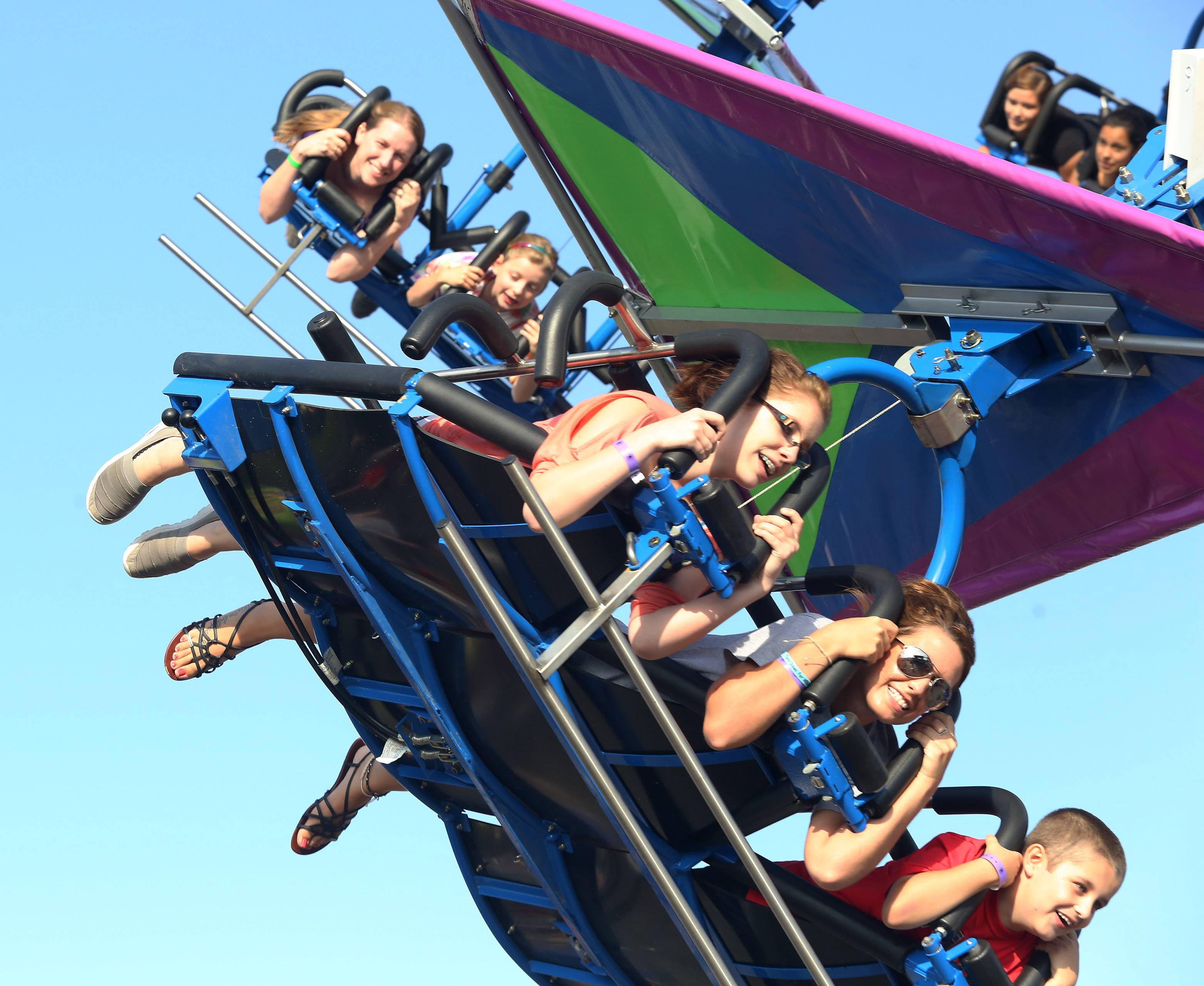 Savannah Remillaro, Maiya Palmisano and Josh Brown ride the Cliff Hanger during the first day of the 35th annual Wauconda Fest at Cook Park on Thursday.