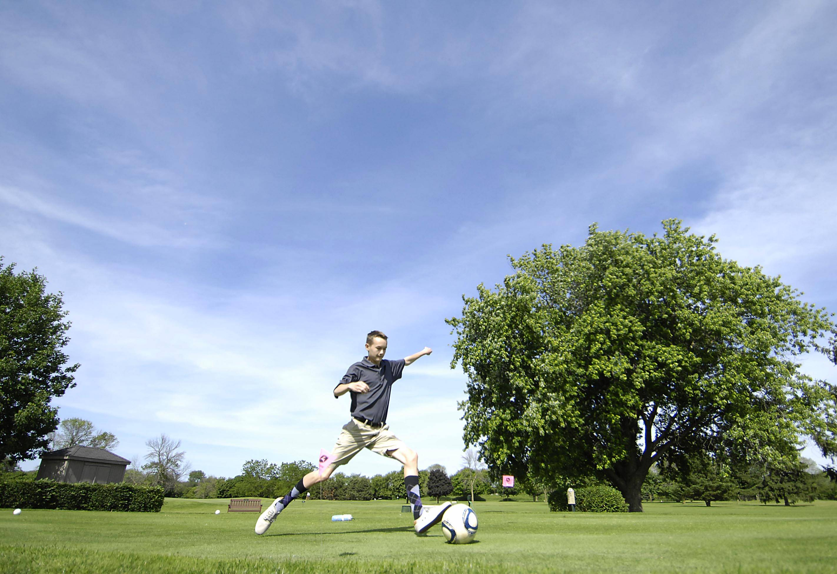 Garrett Otto tees off at Bonnie Dundee Golf Club in Carpentersville as he plays FootGolf with Alex Lenski. Both are 16 and live in Geneva. The sport combines golf with soccer, and is played on a golf course.