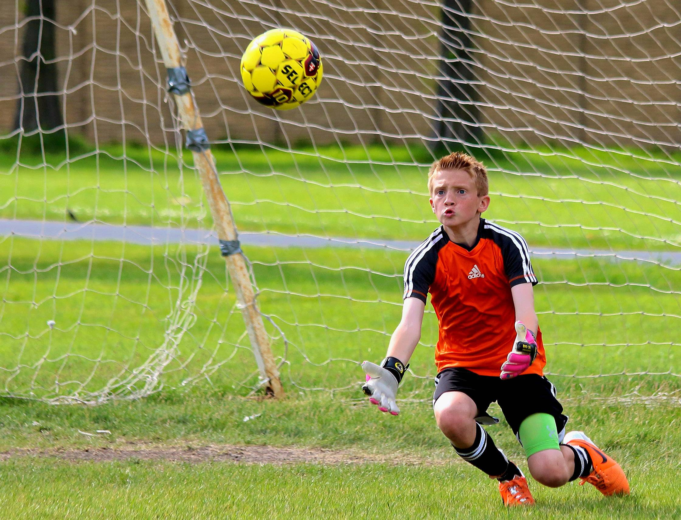 Goalkeeper Trevor Share focuses on the ball as it heads his way during a recent soccer game.