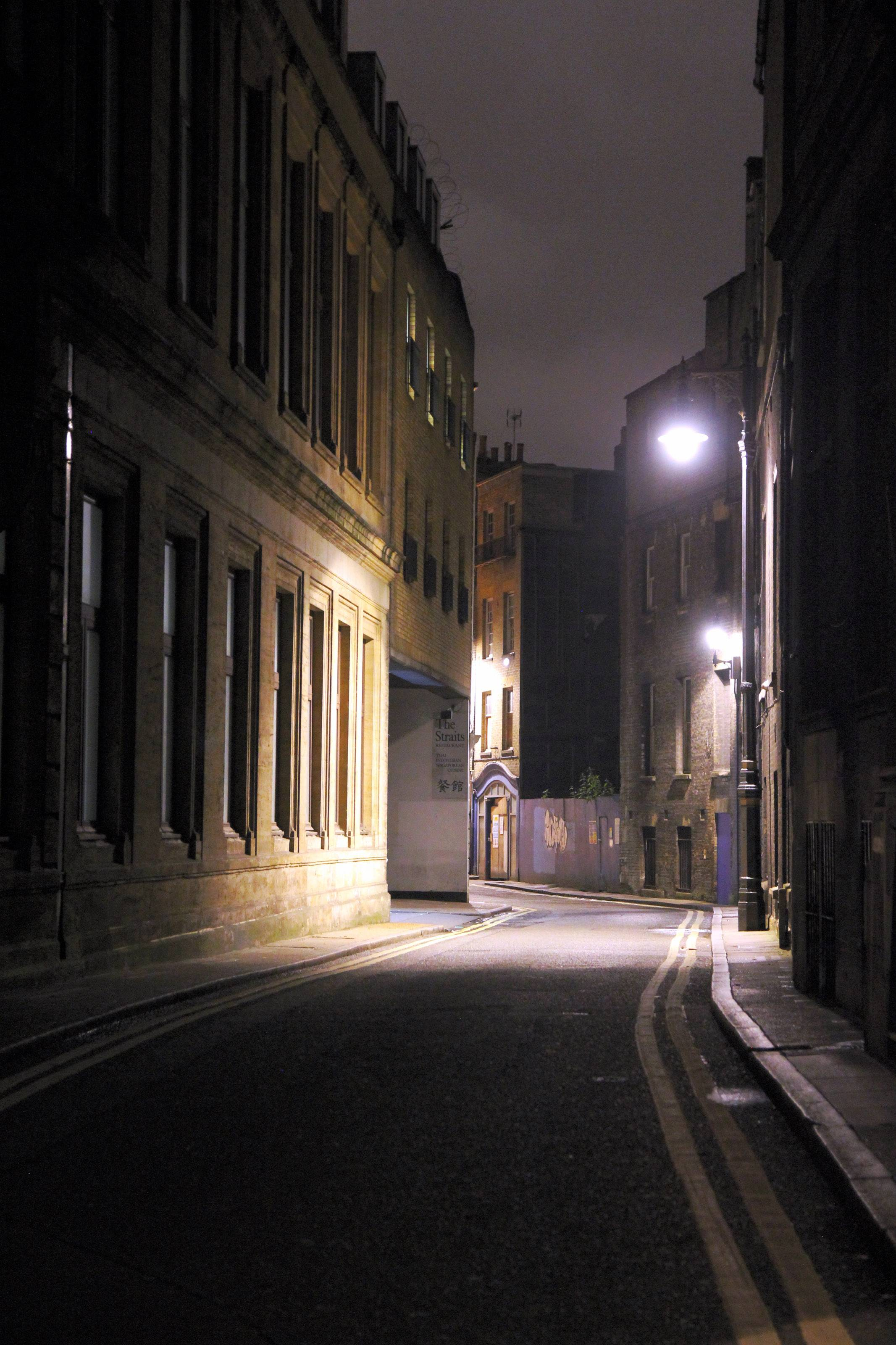 This shot was taken at 1:30 in the morning in London, as my daughter and I were walking back from Piccadilly Circus. The backlit alleyway and leading lines caught my attention. Without a tripod, I snapped this image. I really like how the eye is drawn into the alley with very moody light.