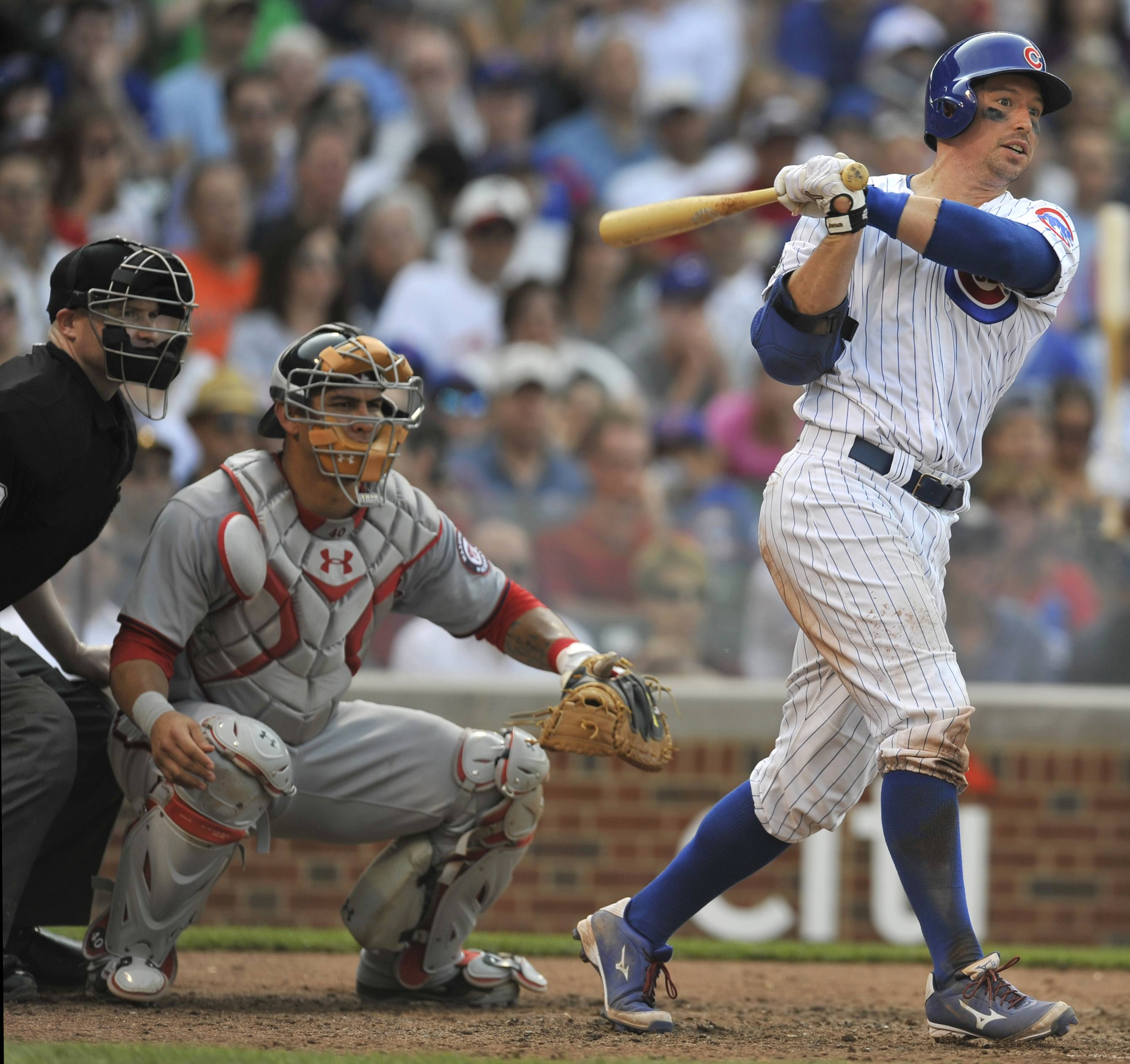Light-hitting catcher John Baker had three hits, a walk and four RBIs, and Cubs starter Jason Hammel again mastered the Washington Nationals in a 7-2 victory Friday.