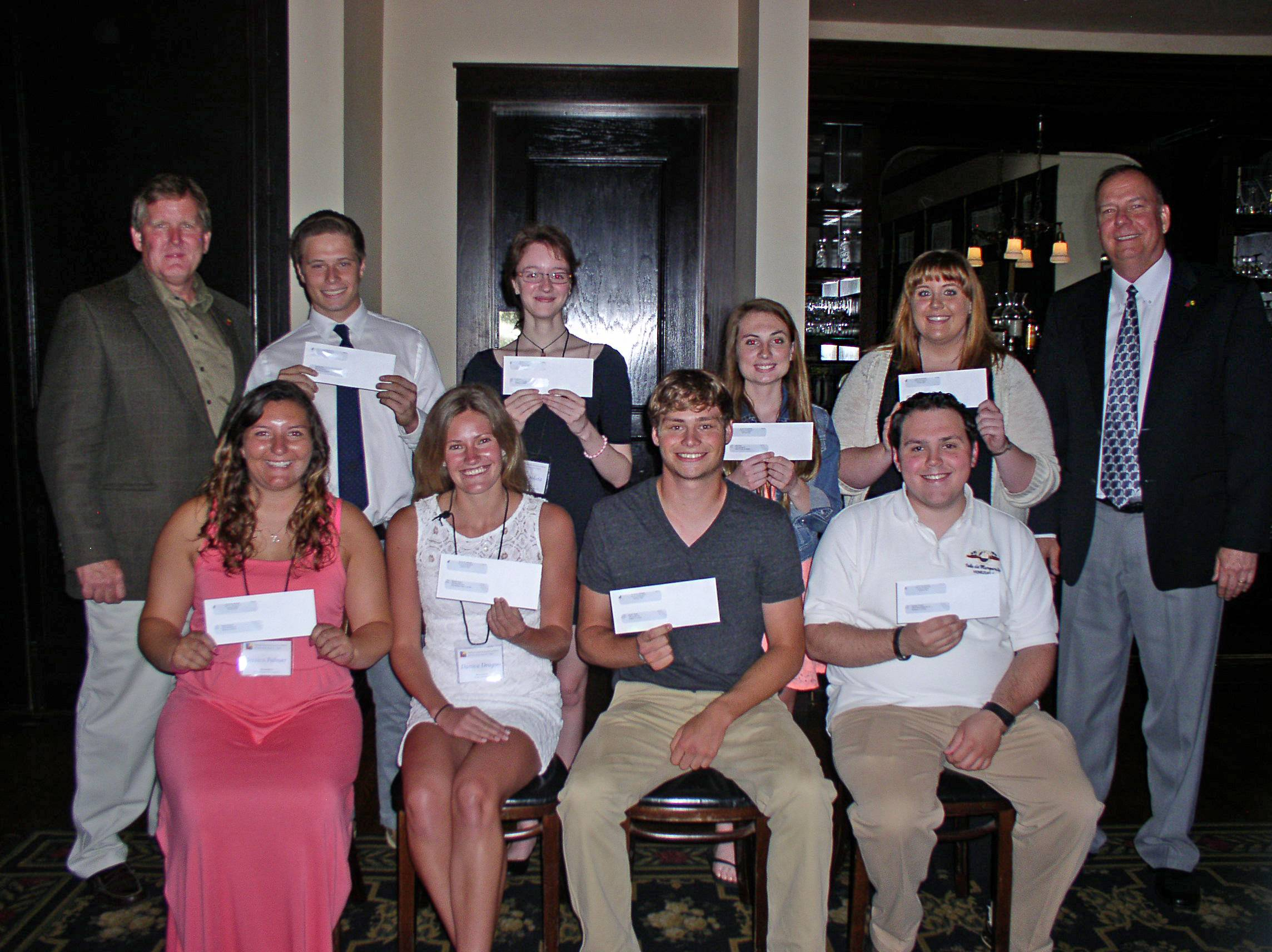 Thirteen college-bound students recently received scholarships from the Finishing Contractors Association of Illinois. Pictured are, front row, from left, Jessica Palmer, Danica Dragoo, Austin Vogel, and Alexander Procaccio for Danesa Tamayo; and back row, Ken Ober, George Cote, Emily Dolata, Jami Dahl, Andrea Cardinal, and Mark Palmer.