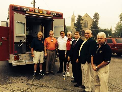 Group with New Ambulance Vehicle; Names from left to right; Matt Tabar, Secretary, Rotary Club; Bob Deiss, President-Elect, Rotary Club; Jon Cokefair, Deputy Chief, Antioch Fire Department; Bill Stanley, Rotary Club; Larry Hanson, Mayor, Village of Antioch; Rev. Bill Landis, Publicity Chair, Rotary Club; Jim Menzer, President, Rotary ClubRick Kuehn, Rotary Club of Antioch