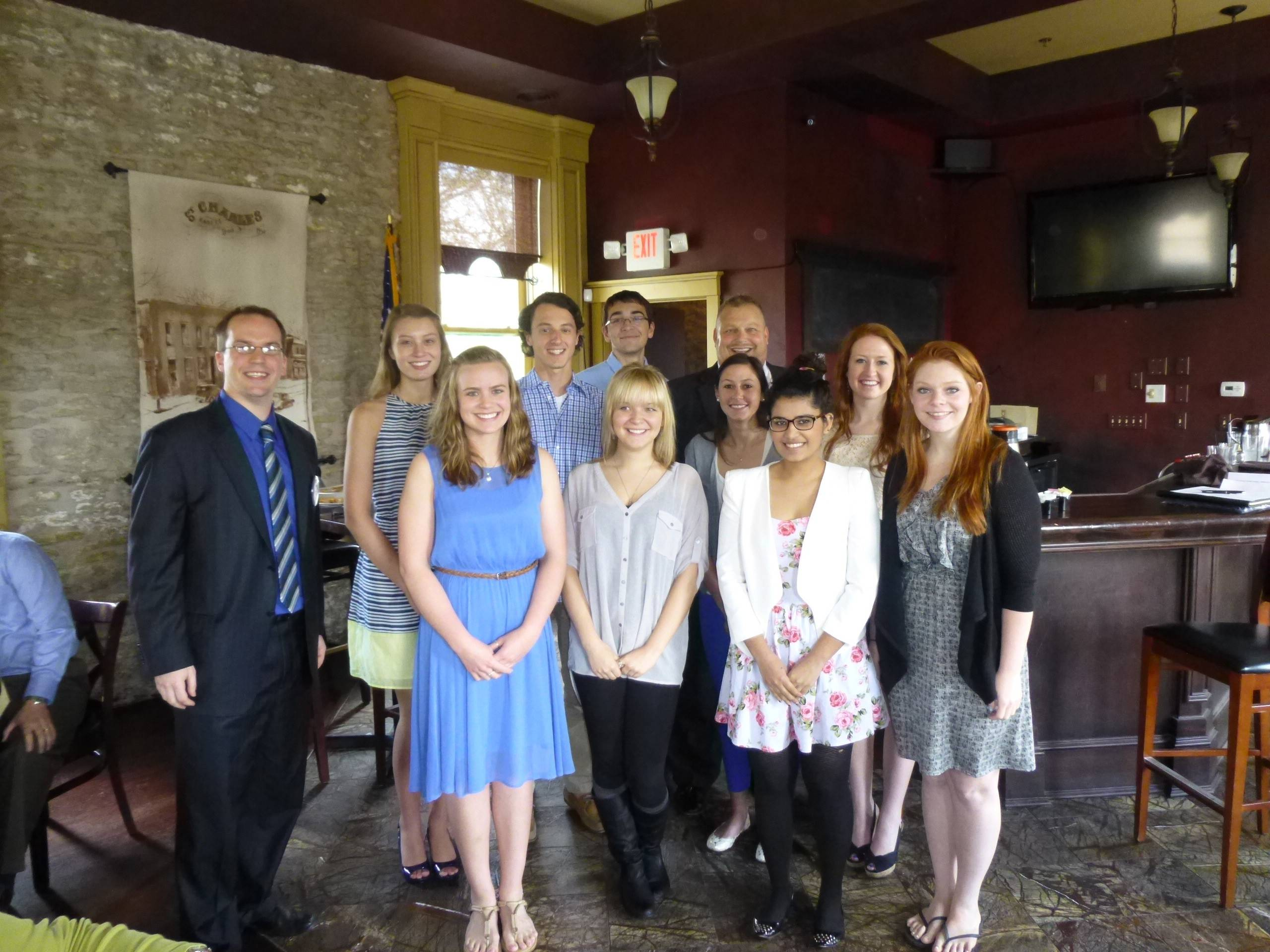 The Rotary Club of St. Charles, with club president-elect Rich Kitick, left, and Dean Carlson, president of St. Charles Rotary Club Foundation, back right, award $16,000 to local students, from left, Claire Davis; Hannah Zimmer; Daniel Beckman; Michael Nelson; Rachel Baumgartner, Maria Ranieri, Alishaa Hasan, Mary MacCarthy, and Ashley Montgomery.