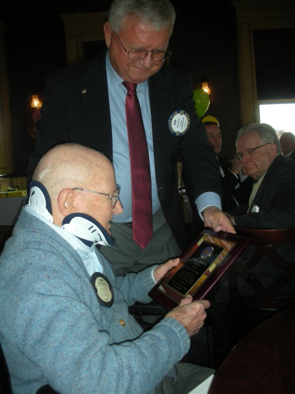In March, Rotary Club of St. Charles President Bob Brown presents John H. Wredling a Lifetime Rotarian Award to honor Wredling for his service and inaugurate the John H. Wredling Scholarship Award.