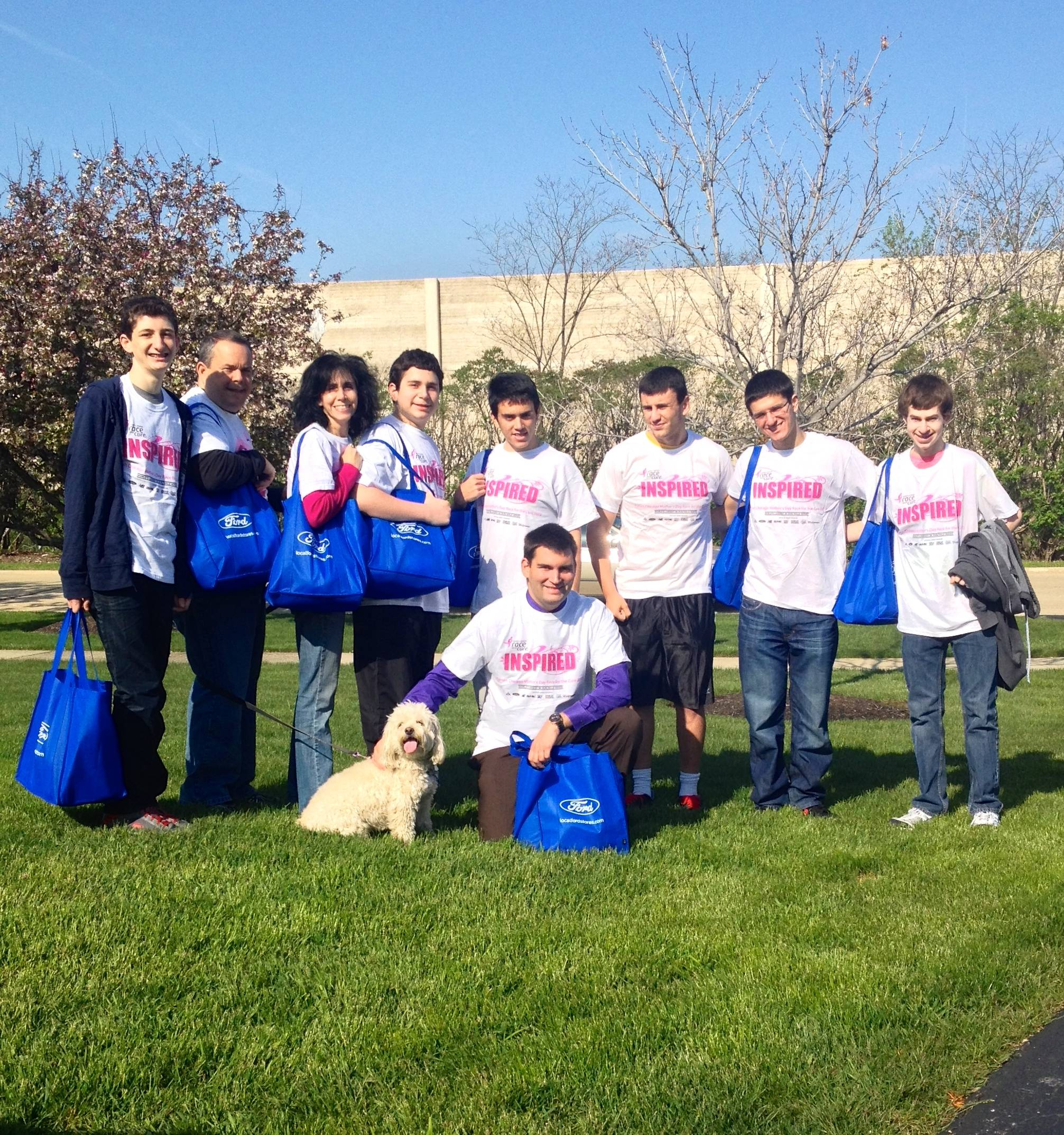 Volunteers wearing 'Inspire' shirts from Susan G Komen get ready to go out and deliver Lox Boxes to the Chicagoland communityBBYO