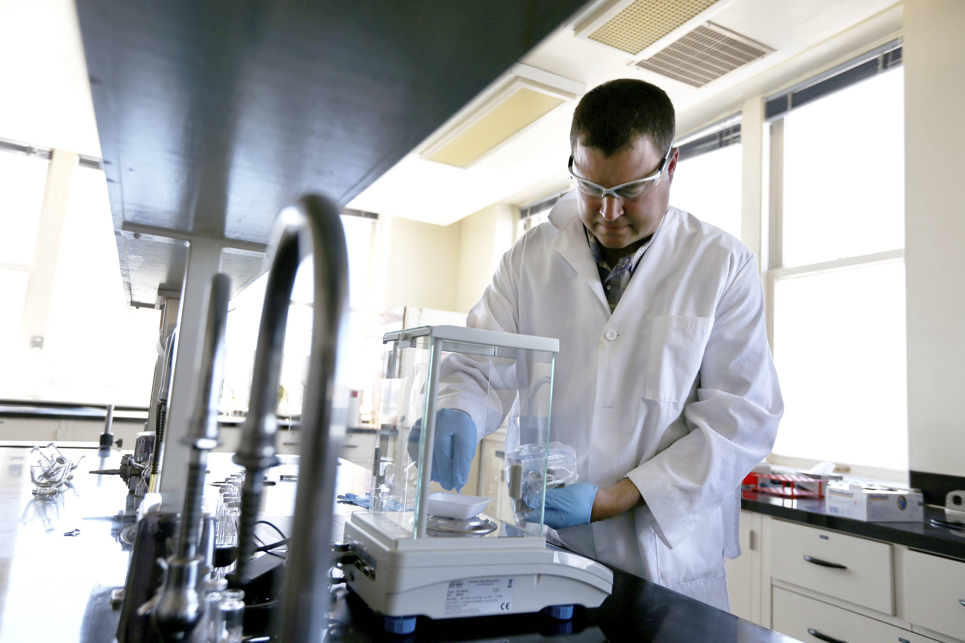 Randy Oliver, the chief scientist for Analytical 360, weighs out a sample of marijuana at its new cannabis analysis laboratory, in Yakima, Wash.
