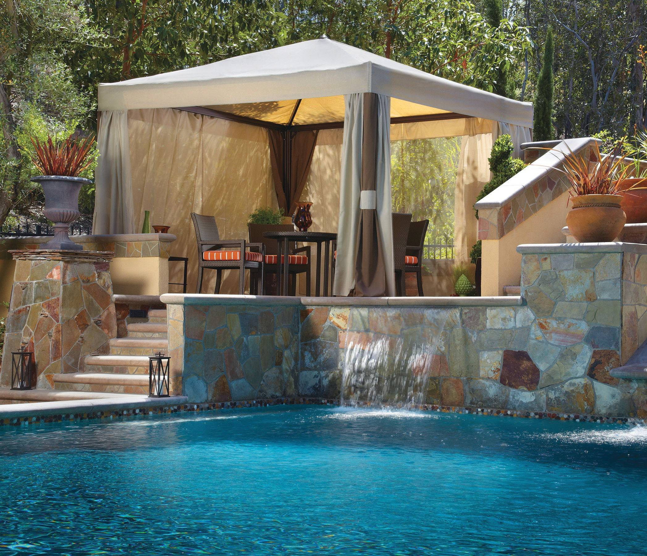 Spacious tented pavilions with tieback draperies provide an instant, private outdoor room.