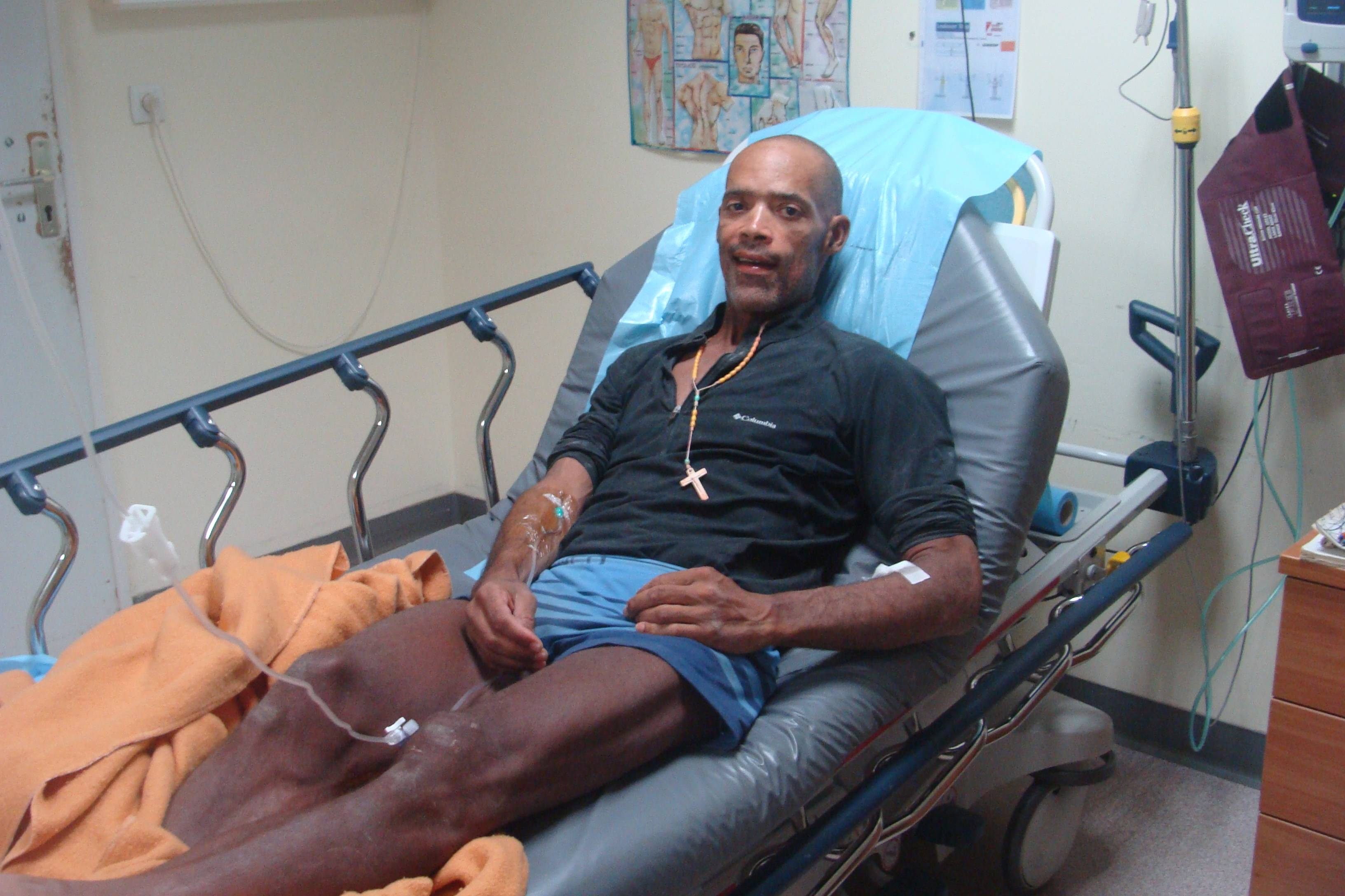 Victor Mooney, 48, of Flushing, Queens, New York lies in his hospital bed after arriving in Saint-Martin Friday.