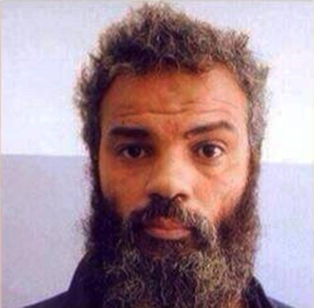 This undated file image obtained from Facebook shows Ahmed Abu Khattala, an alleged leader of the deadly 2012 attacks on Americans in Benghazi, Libya, who was captured by U.S. Special Forces on Sunday, June 15, on the outskirts of Benghazi. Khattala, charged in the 2012 Benghazi attacks, is in U.S. custody amid tight security at the U.S. Federal Courthouse in Washington, Saturday, June 28. Khattala faces criminal charges in the deaths of the U.S. ambassador to Libya and three other Americans.