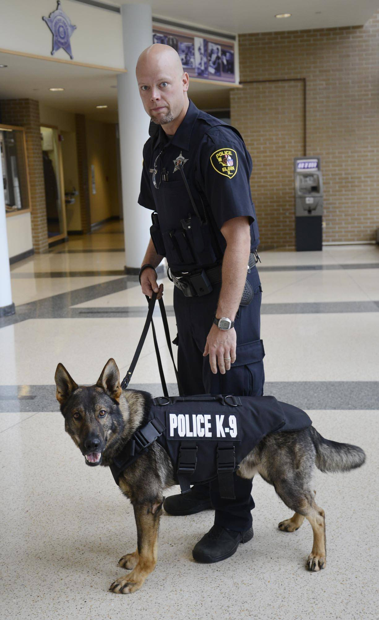 Elgin Police Officer Chad Schuttrow with K9 Colt, who received a donated ballistic vest through a partnership between Groupon and Vested Interest in K9s, Inc. Colt is a German shepherd.
