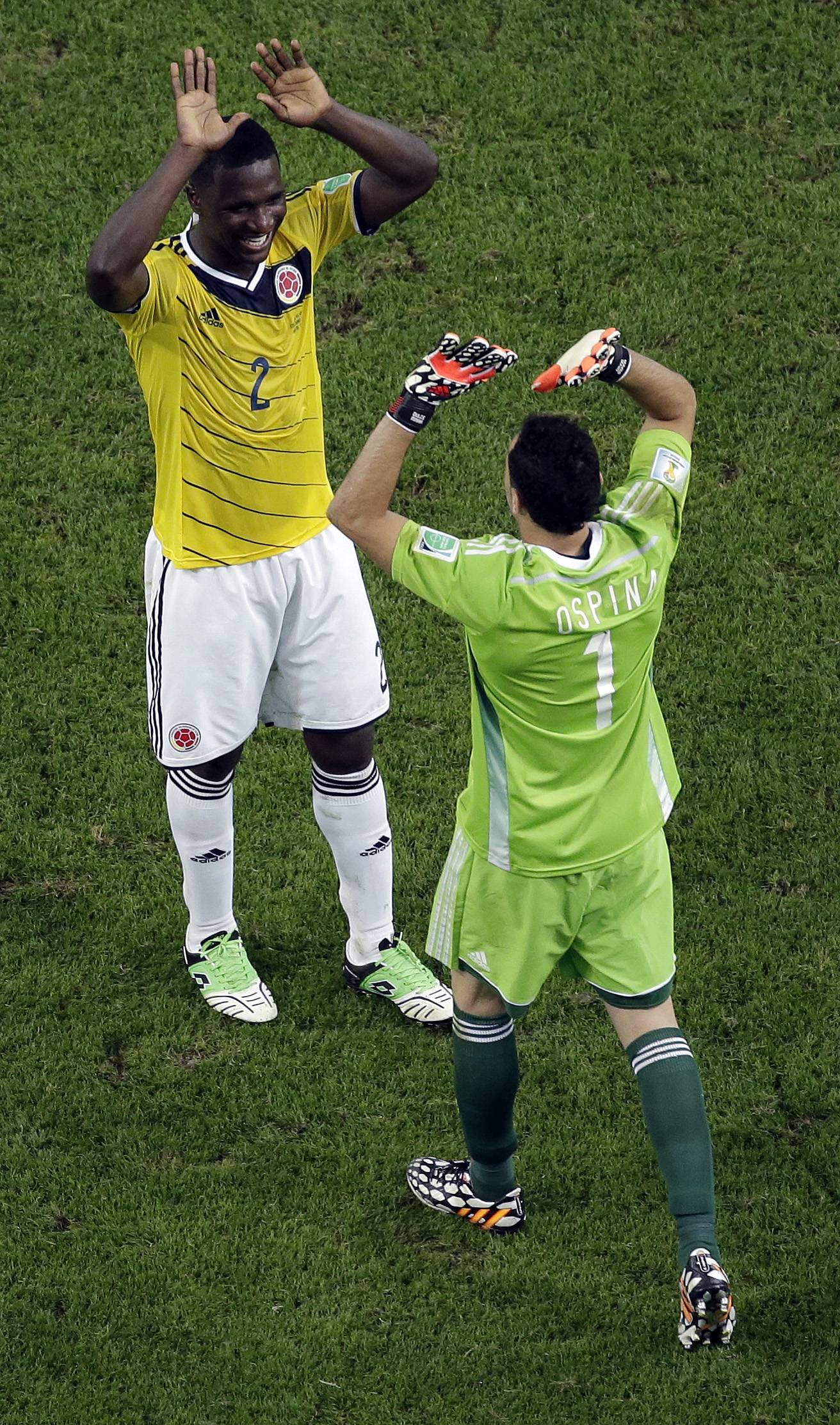 Colombia's Cristian Zapata, left, and goalkeeper David Ospina celebrate after the World Cup round of 16 soccer match between Colombia and Uruguay at the Maracana Stadium in Rio de Janeiro, Brazil, Saturday, June 28, 2014. Colombia advanced to the quarterfinals with a 2-0 win over Uruguay. (AP Photo/Felipe Dana, pool)