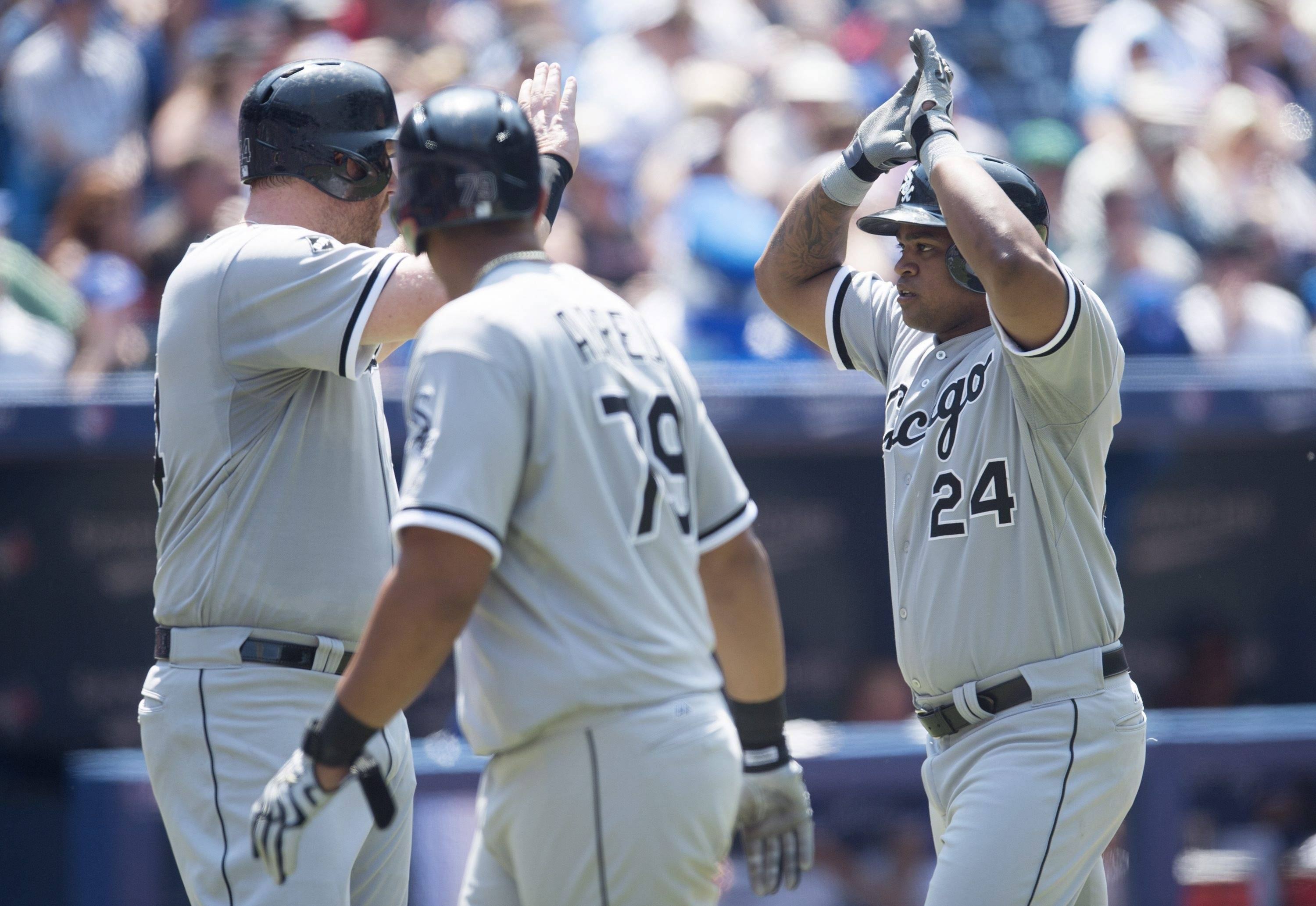 The White Sox's Dayan Viciedo, right, celebrates his three-run home run with teammates Adam Dunn, left, and Jose Abreu during Saturday's game in Toronto. The White Sox beat the Blue Jays 4-3.