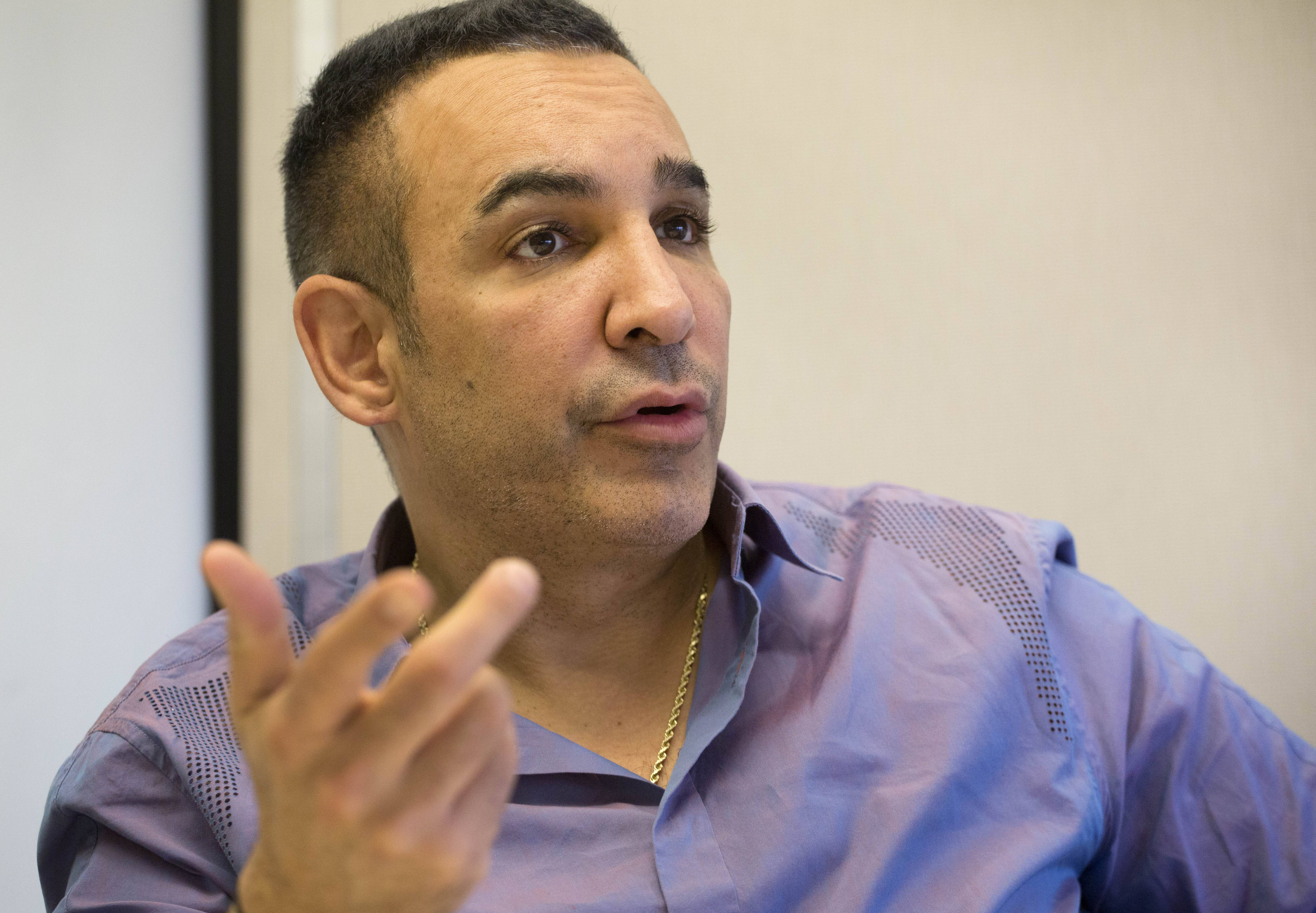 In this March 27, 2014 photo, Alki David, CEO of FIlmOn, is interviewed at The Associated Press in New York. FilmOn offers over-the-air TV channels through a website and mobile apps.