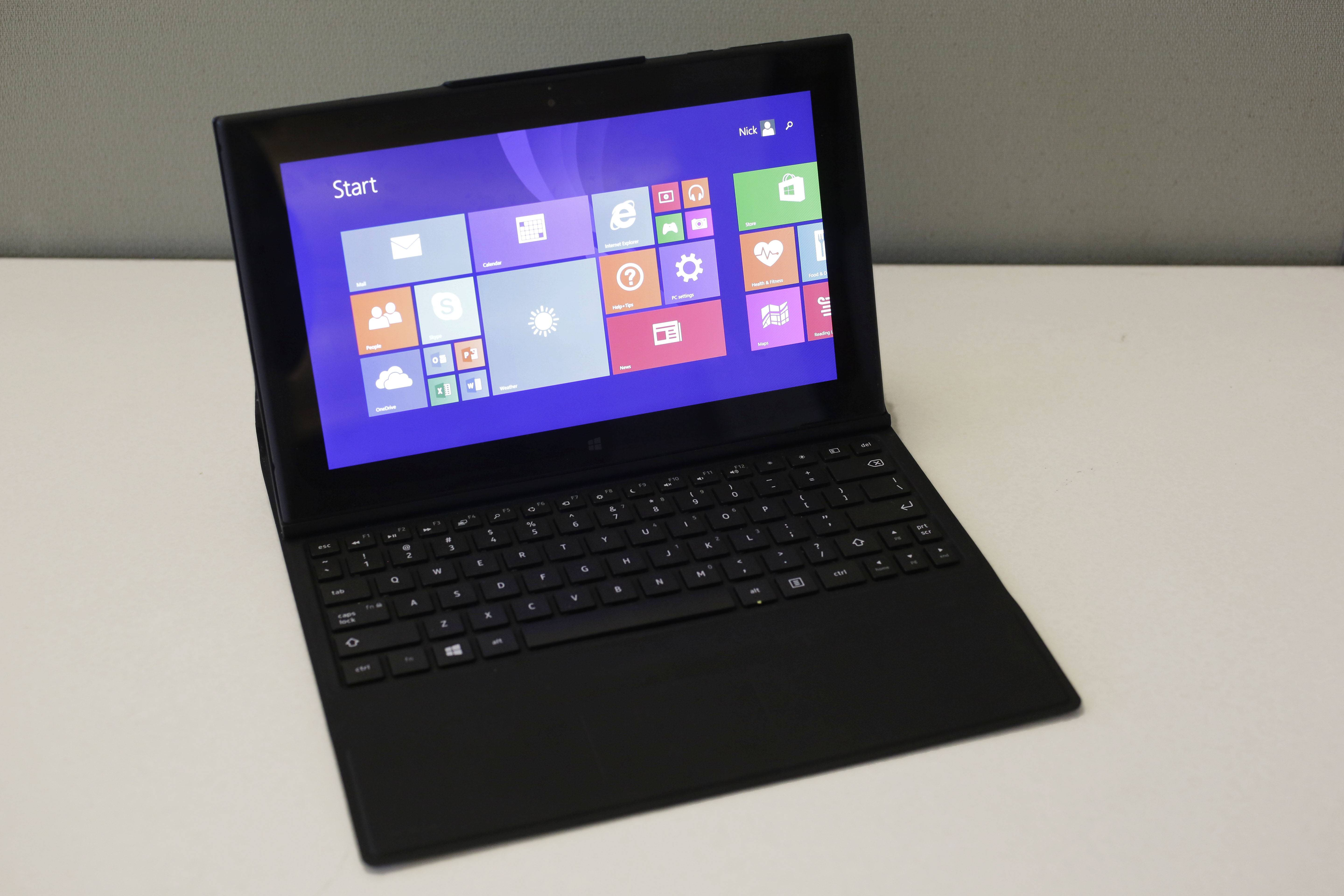 This Friday, June 20, 2014 photo shows the Lumia 2520 tablet and keyboard, in New York. The tablet starts at about $600 and the optional keyboard cover is another $150.