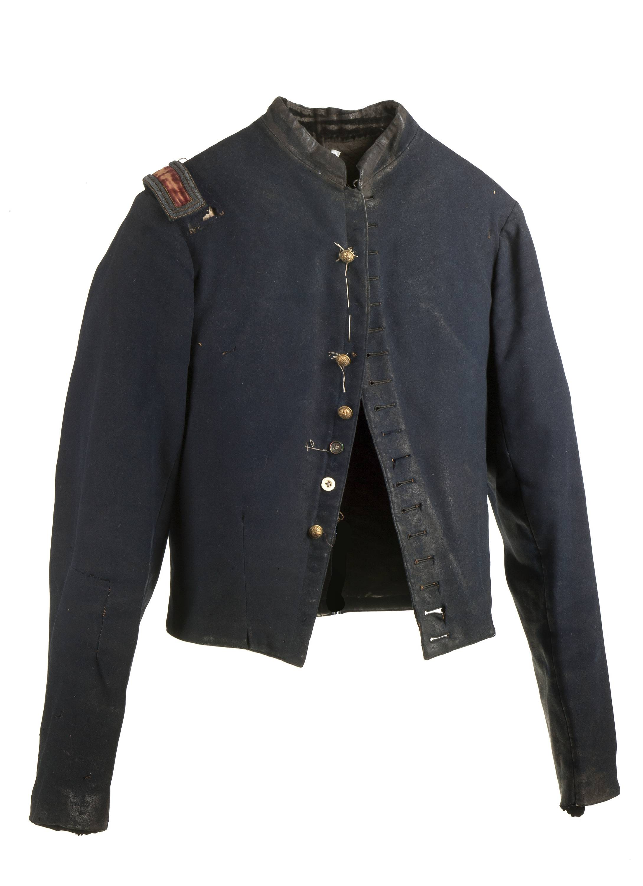 "This torn and stained field jacket worn by William Henry Shelton, a New York officer, who was captured on May 5, 1864, and wore the jacket during his 10 months of imprisonment and multiple escapes in Georgia and South Carolina, is on display in ""Homefront and Battlefield: Quilts and Context in the Civil War,"" a traveling exhibit on view in New York."