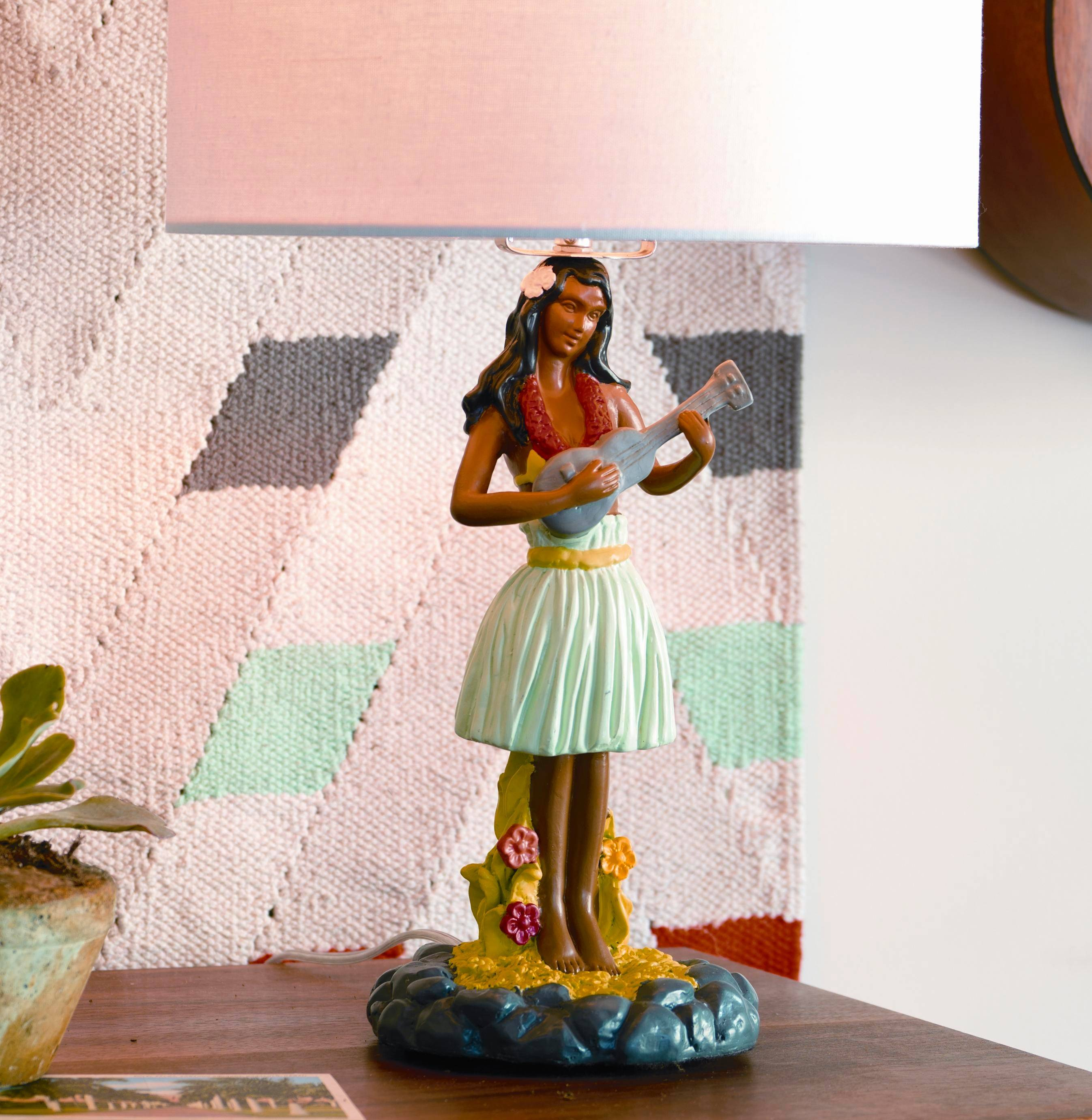 Hawaiian kitsch at its finest, this polyresin hula girl lamp strums just the right retro note. American Retro is a current design trend.