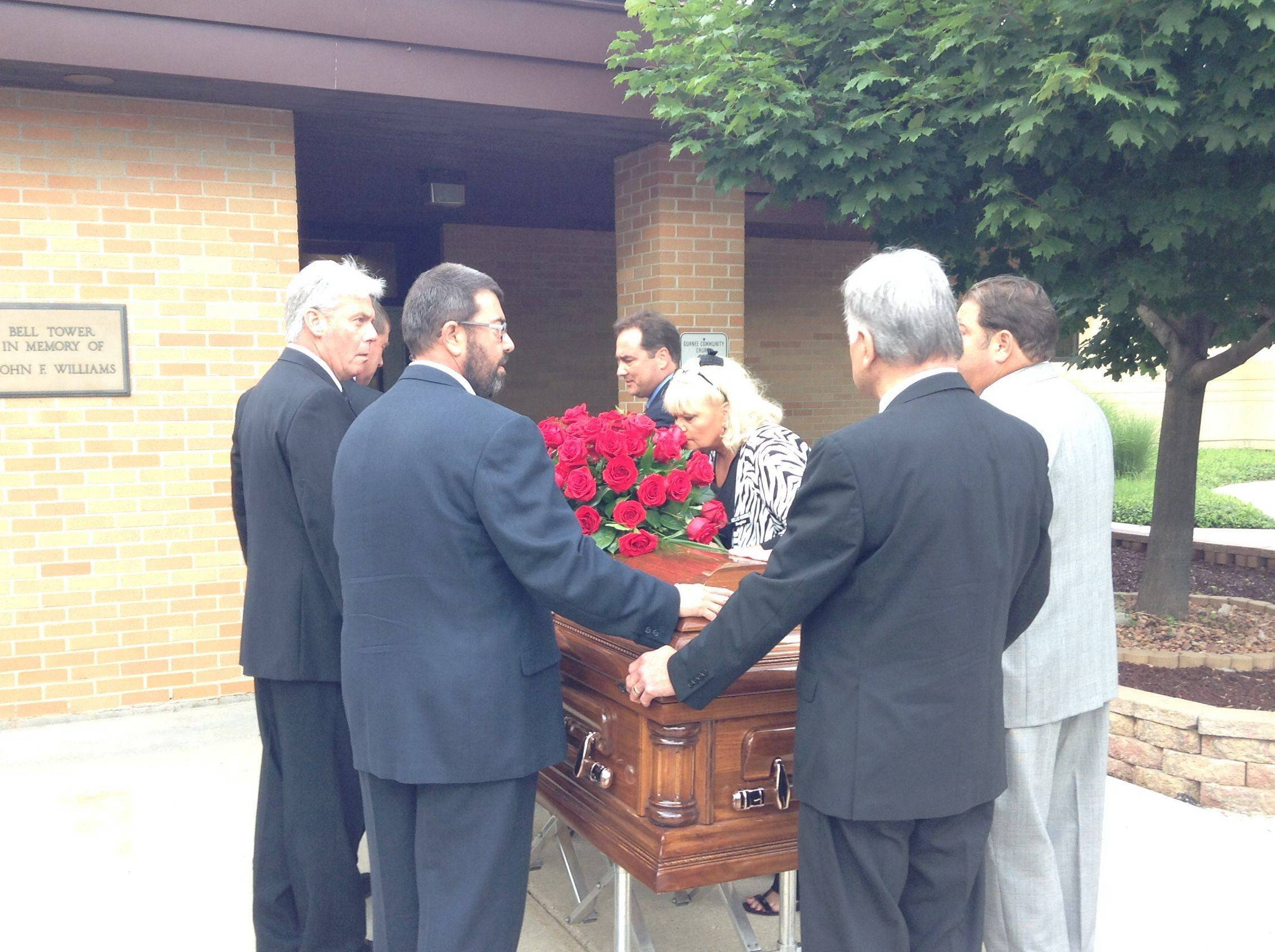 Family members of Robert W. Depke escort his casket into the Gurnee Community Church for the longtime Lake County politician's memorial service Saturday.