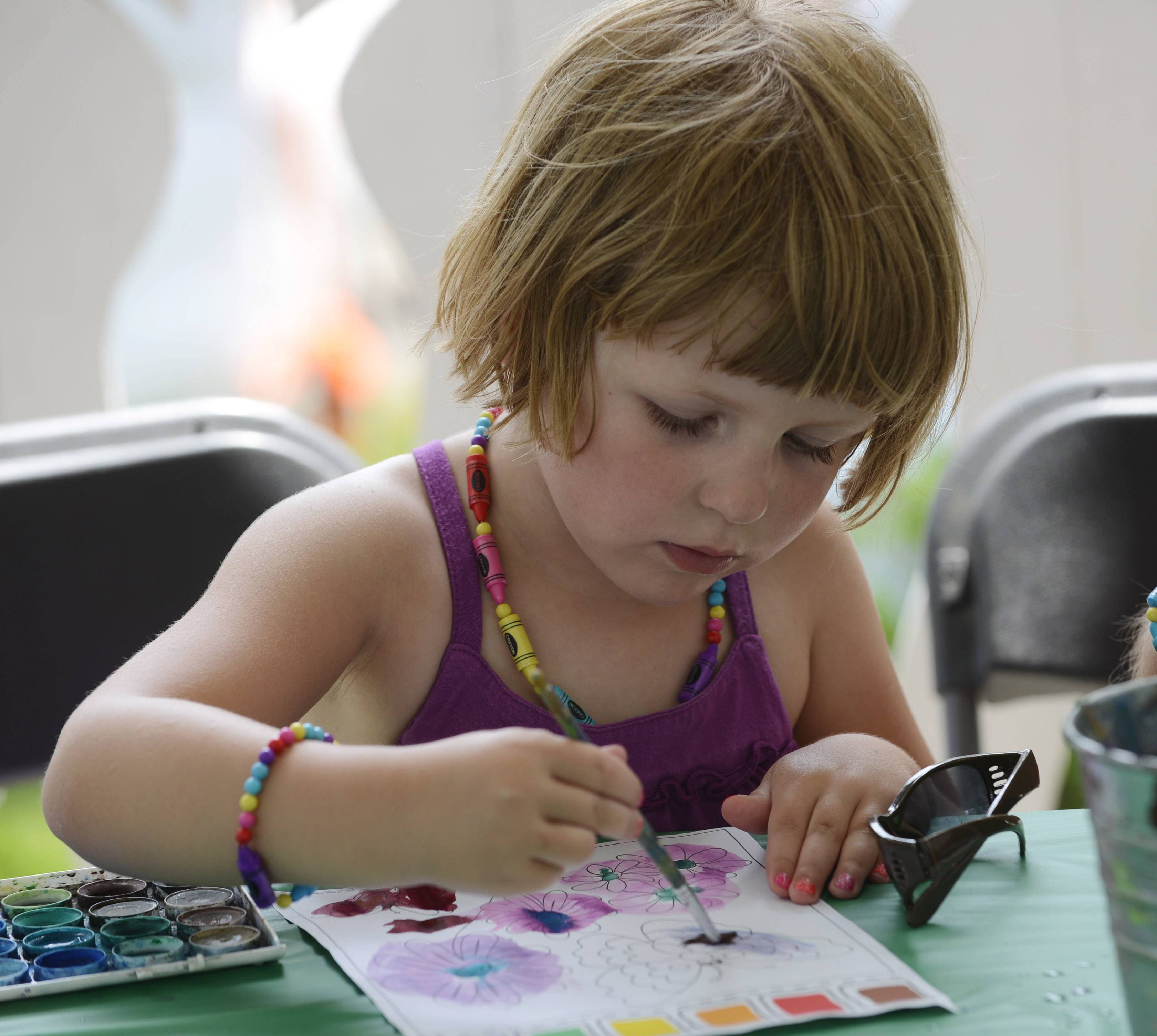 Veronica Baran, 4, of Bartlett paints with watercolors during the Arts in Bartlett Festival of the Arts event at Bartlett Park Saturday.