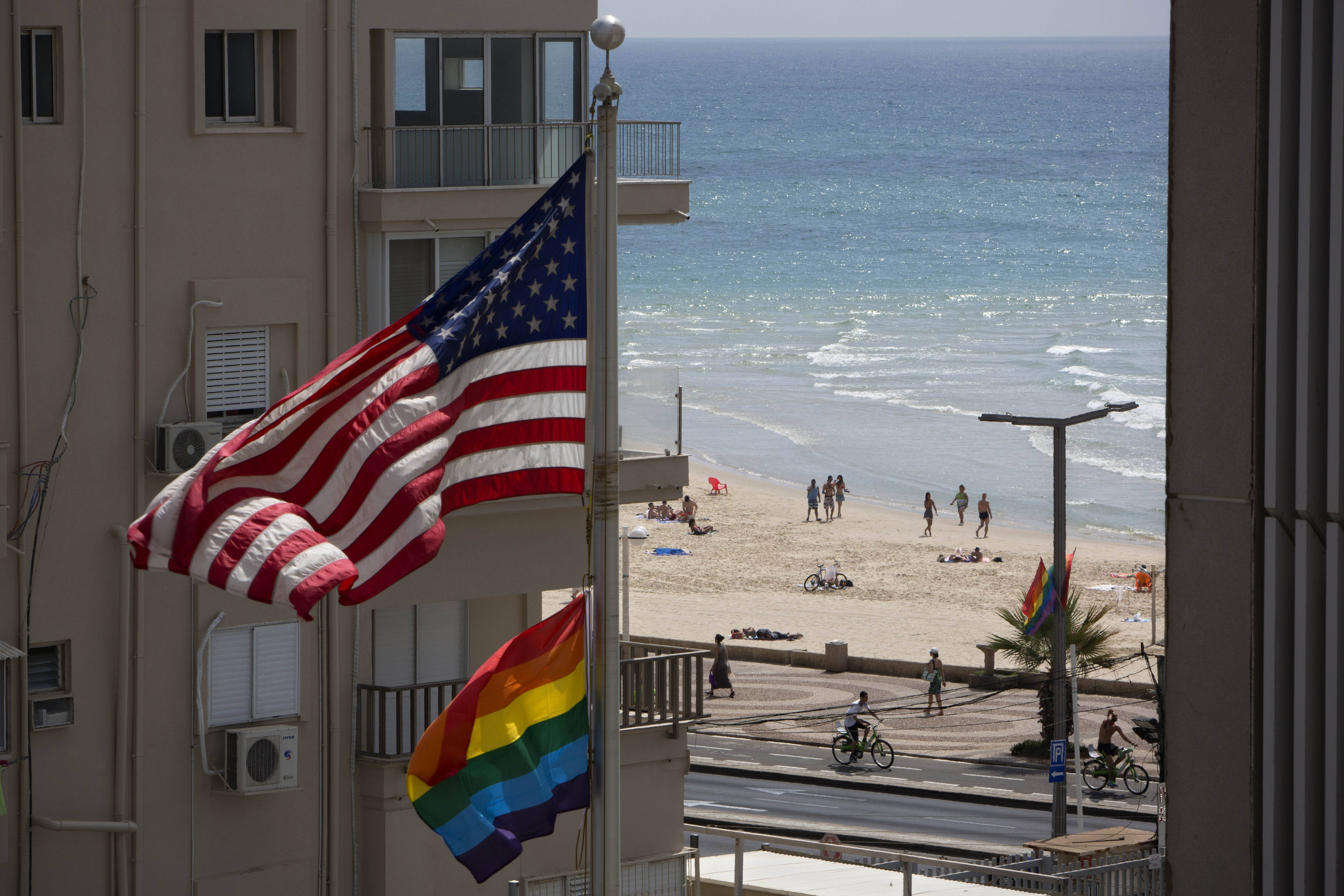 On June 12 a U.S. flag is raised alongside a pride flag on the U.S. Embassy a day before the Gay Pride Parade in Tel Aviv, Israel.