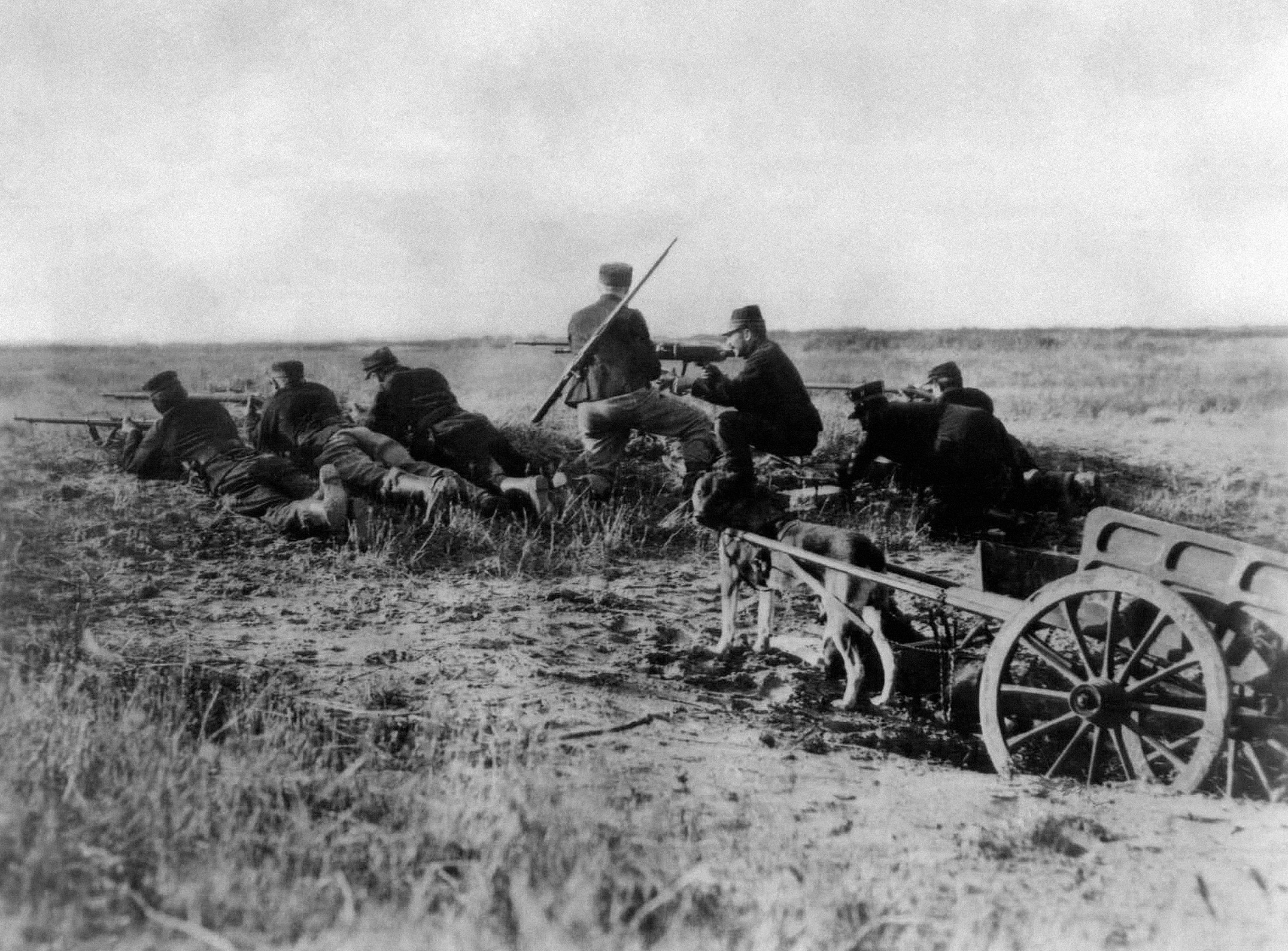 11 OF 100: In this August 1914 file photo, a Belgian machine gun detachment sets up near Haelen, Belgium. The Belgians often used dogs to draw the ammunitions cart. The Battle of Haelen was also known as the Battle of the Silver Helmets.