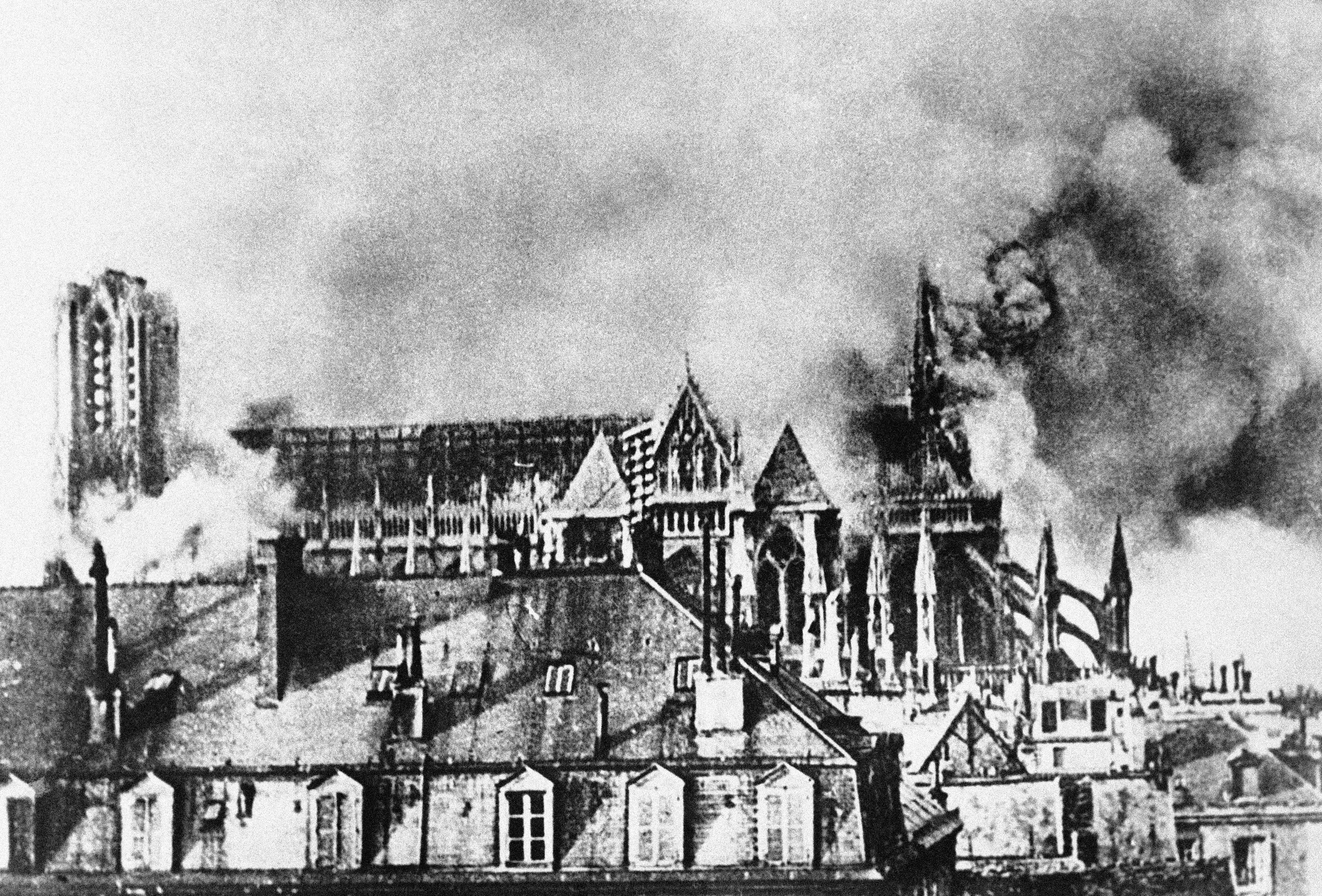 13 OF 100: In this September 1914 file photo, the Cathedral of Reims, France smokes after bombardment during World War I. The advancing German army heavily damaged the city.