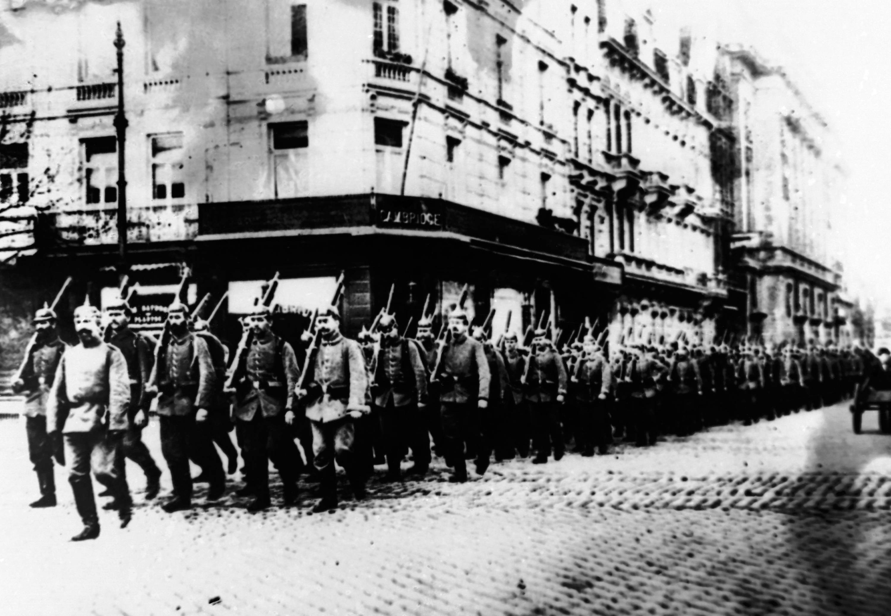 17 OF 100: In this 1914 file photo, German troops march through the streets of Antwerp, Belgium, during World War I.