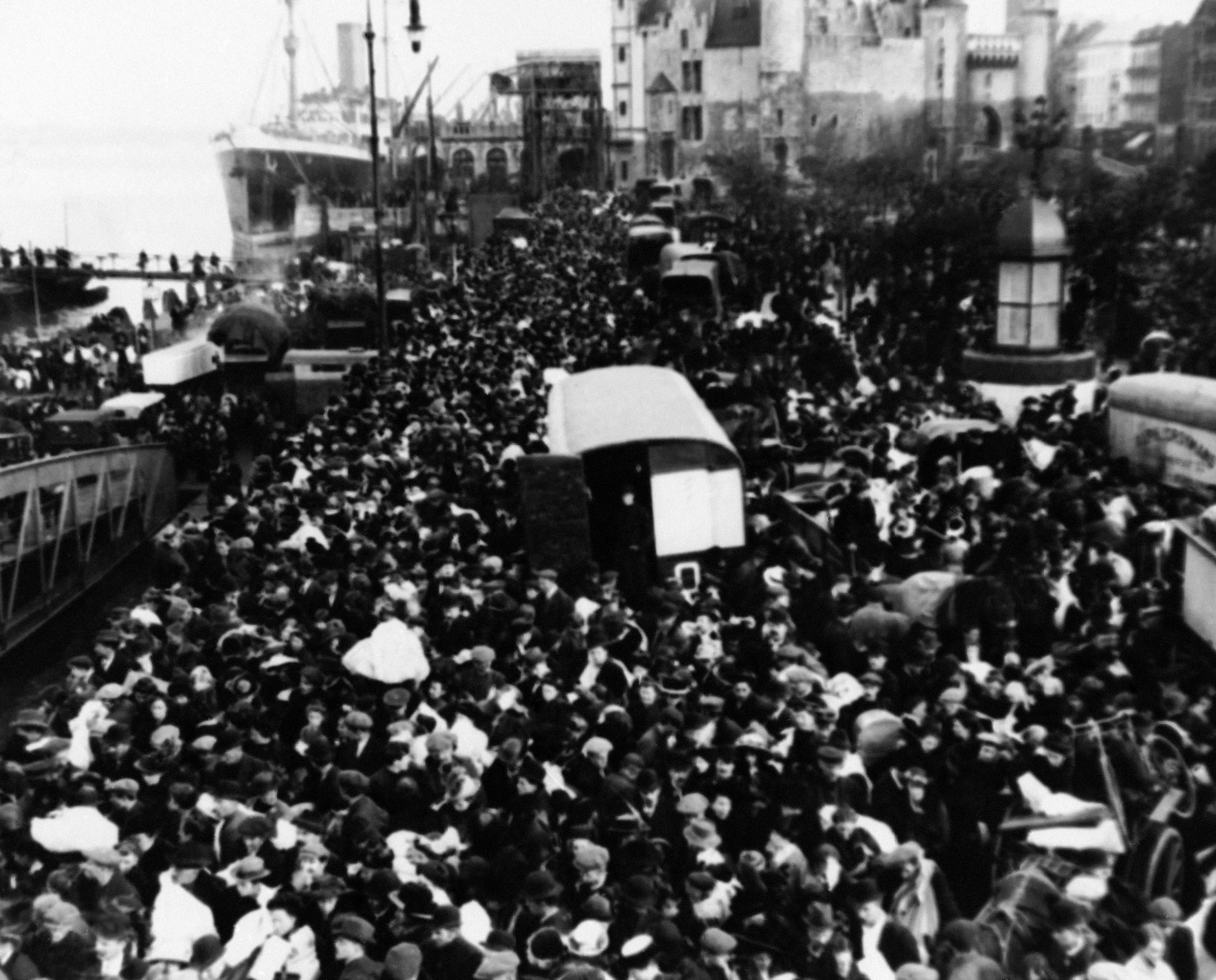 18 OF 100: In this October 1914 file photo, people crowd the Antwerp quaysides as they prepare for an exodus out of the city during World War I.