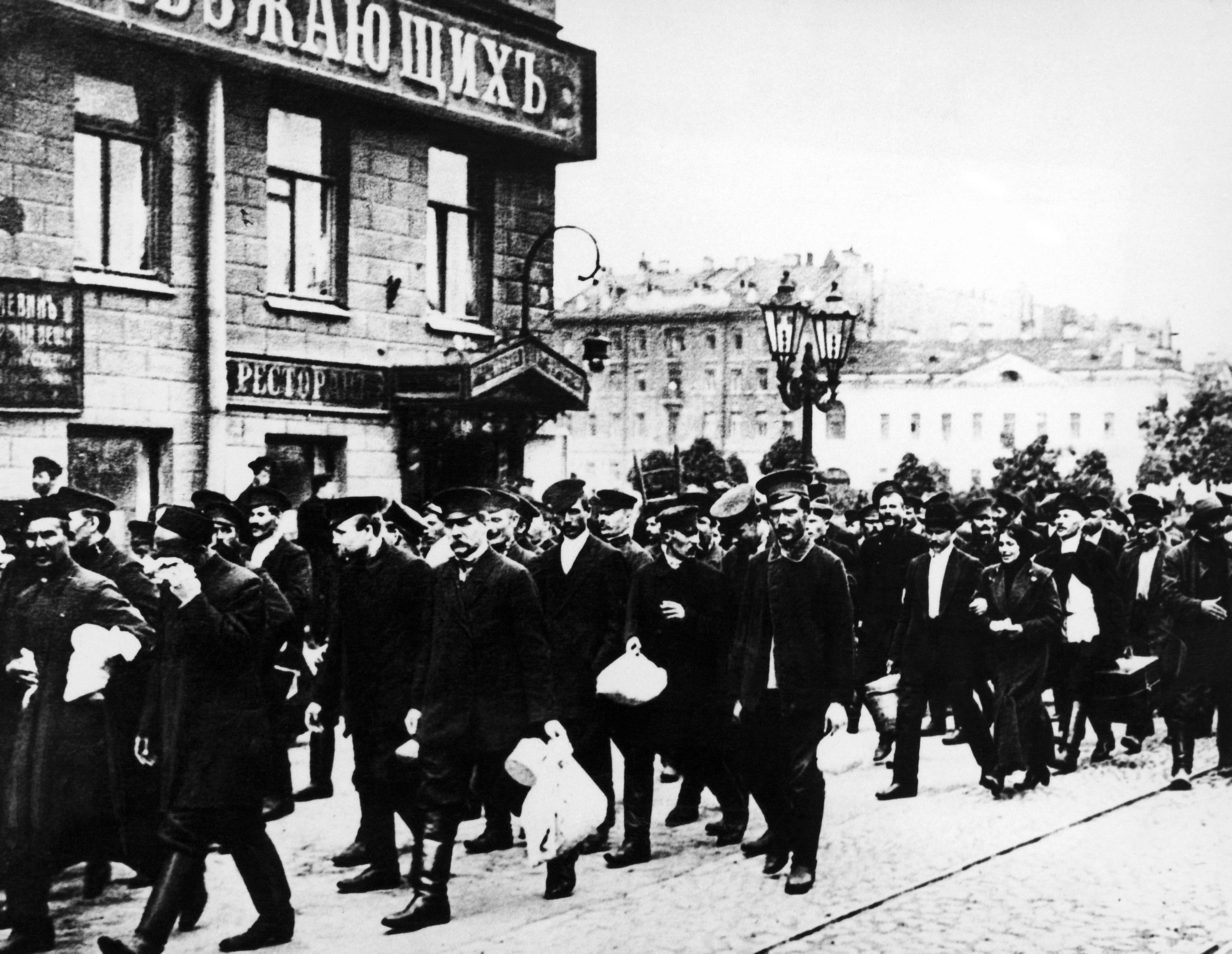 THREE OF 100: In this Aug. 8, 1914 file photo, Russian reservists walk with their belongings in St. Petersburg, Russia. Russia entered World War I with an army which was massive but badly armed.