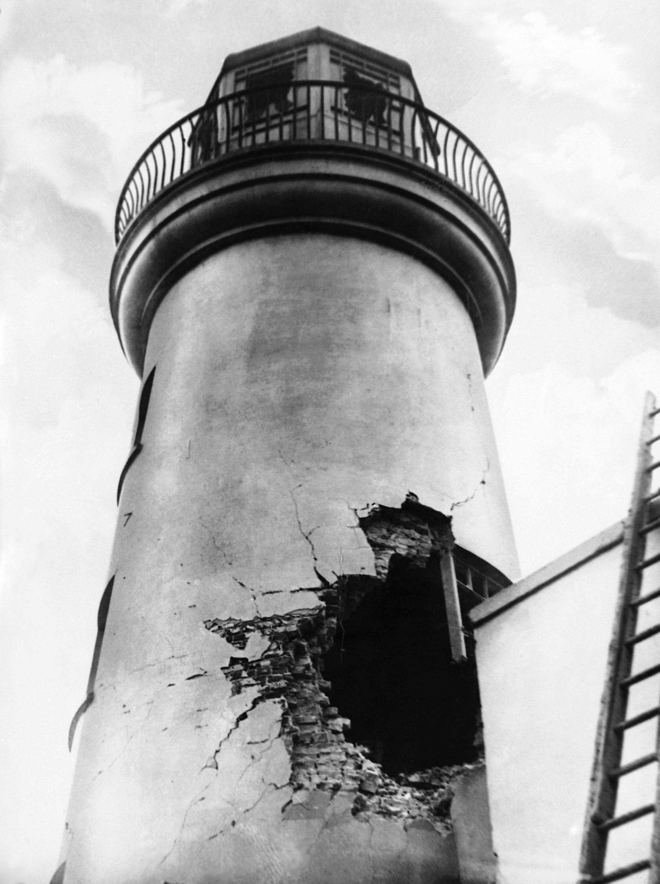22 OF 100: In this December 1914 file photo, damage from German bombardment to the lighthouse in Scarborough, northern England, during World War I.