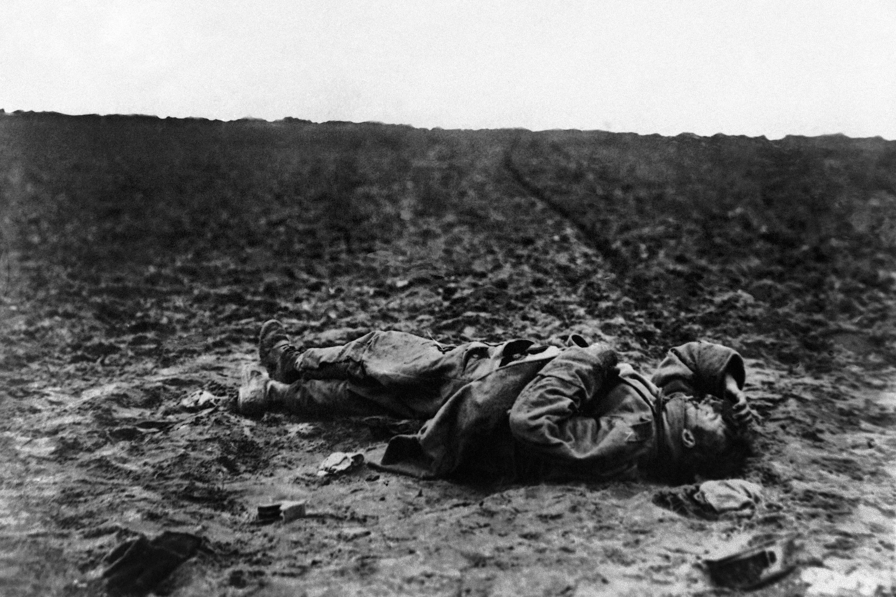 27 OF 100: A lone wounded Austrian soldier lies on the field of battle during World War I in an undated photo.