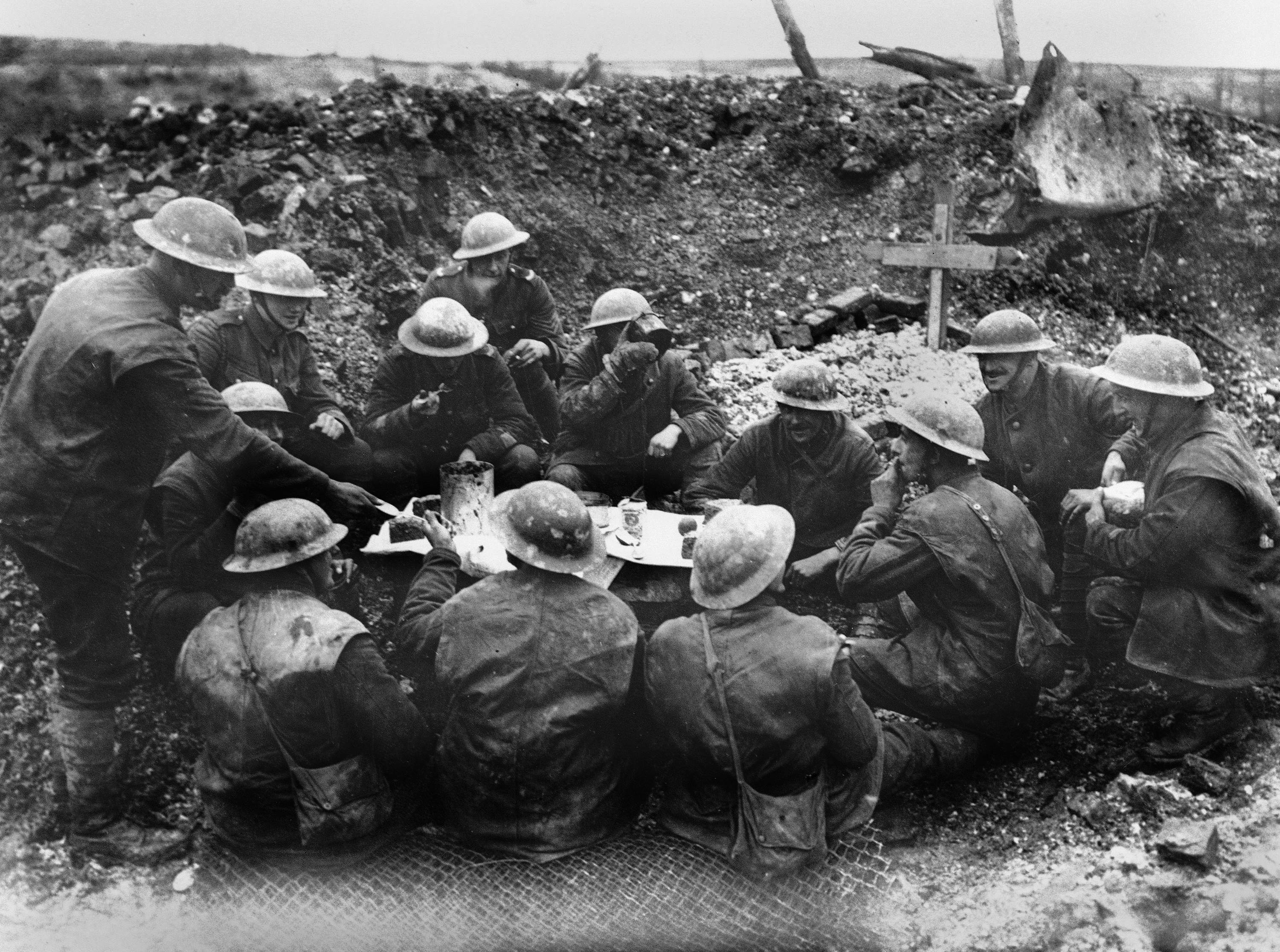 28 OF 100: In this undated file photo, Allied soldiers eat and drink in a shell hole in France during World War I.