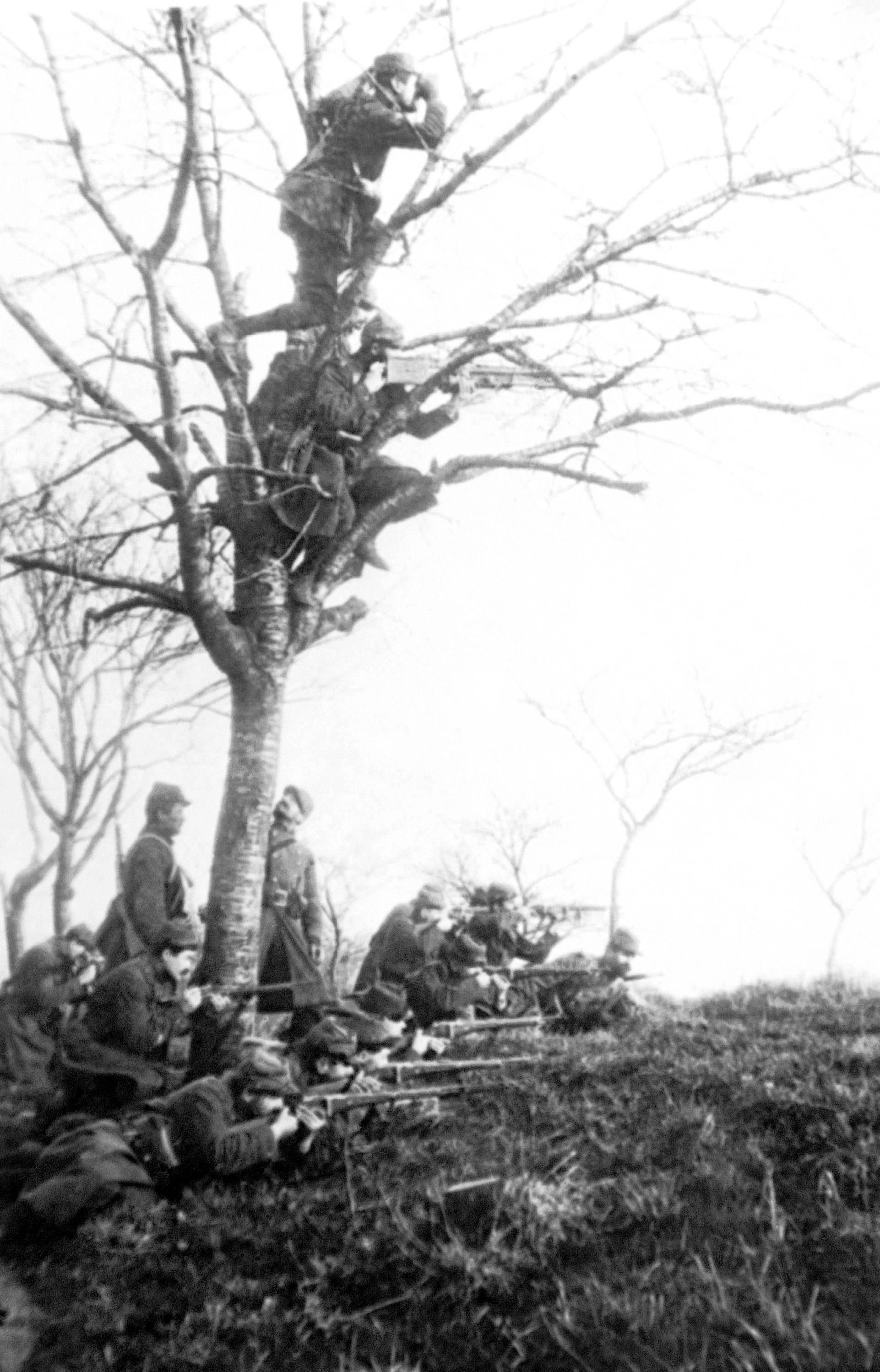 34 OF 100: In this undated file photo, French troops man a lookout in France during a battle in the Argonne Forest during World War I.
