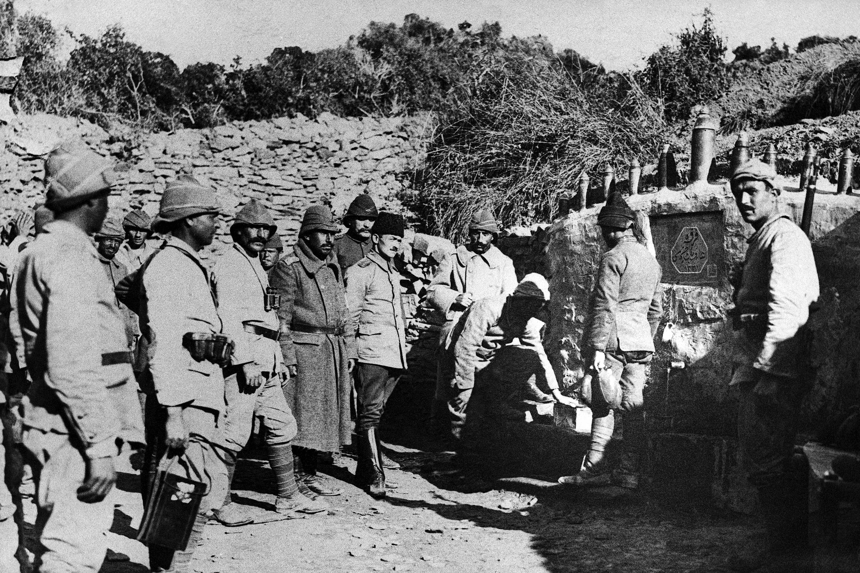 38 OF 100: In this 1915 file photo, Turkish soldiers form a queue to get water from a fountain, behind their lines in Gallipoli, Turkey.