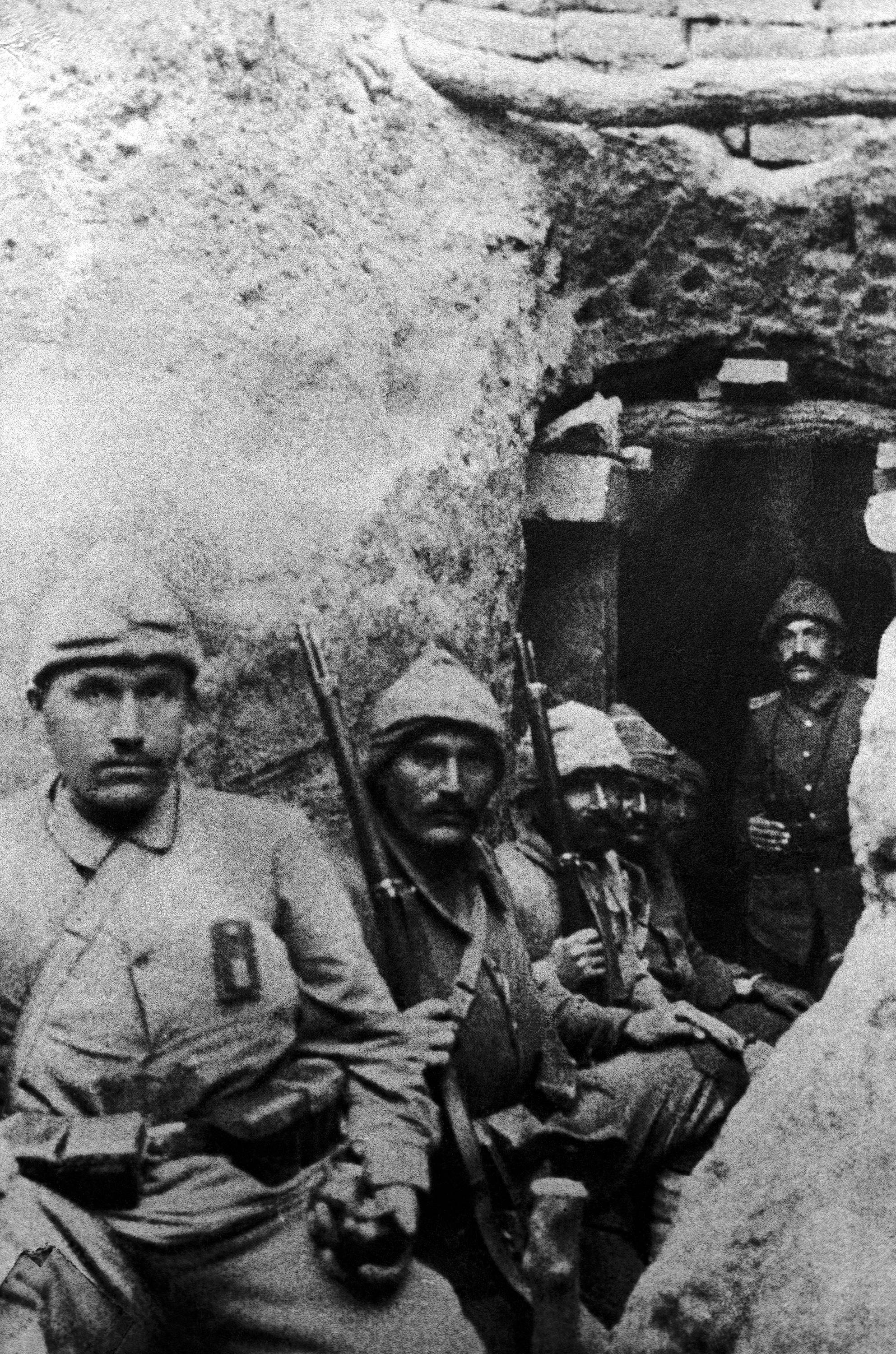 39 OF 100: In this 1915 file photo, Turkish soldiers take a rest during fighting, with their guns in their hands, in a trench in Gallipoli, Turkey.