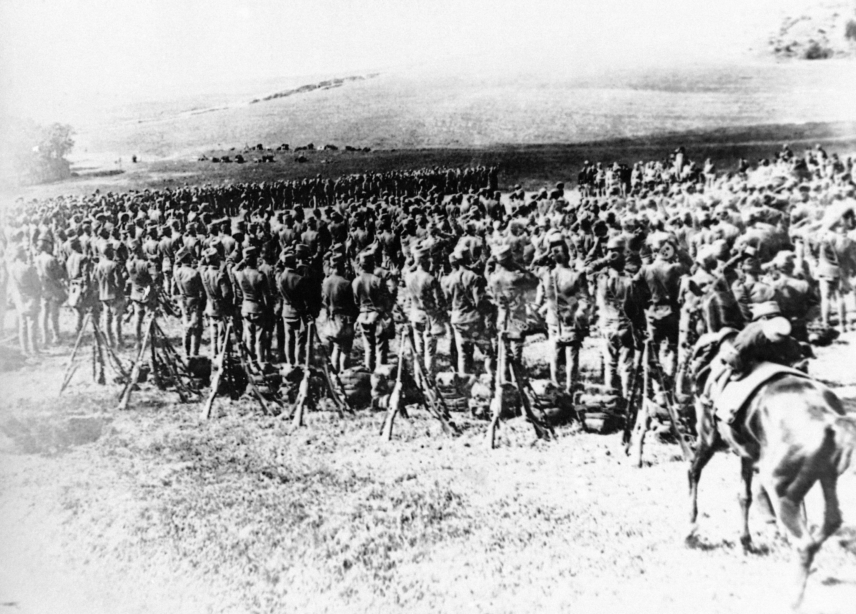 42 OF 100: In this undated file photo, troops are mobilized on the bank of the Danube River across from Belgrade during World War I. Austrian forces captured the Serbian capitol on Oct. 9, 1915.