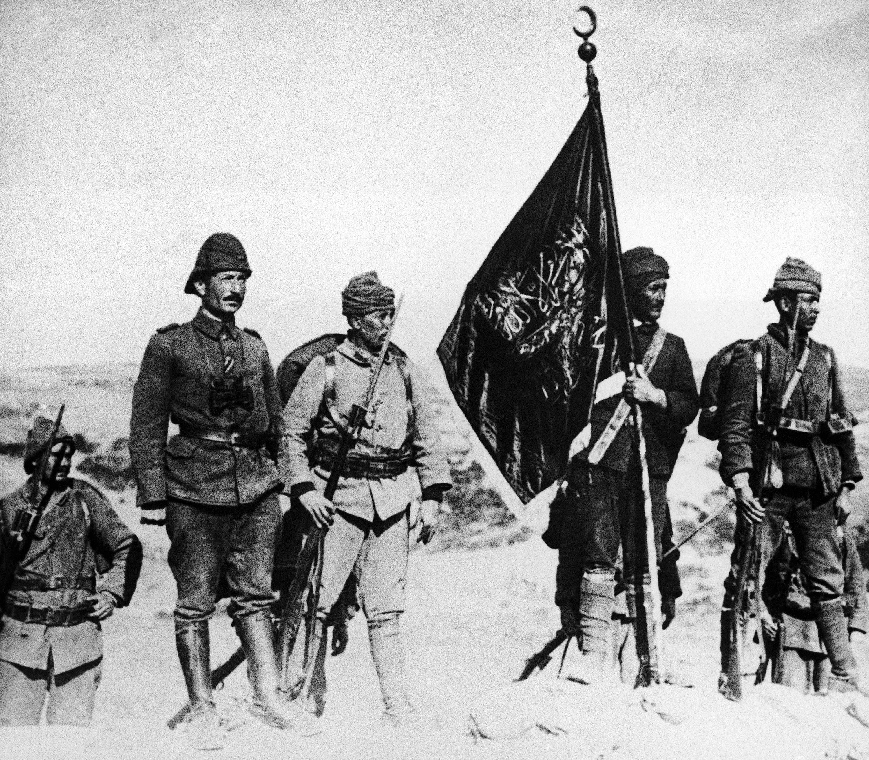 43 OF 100: In this 1915 photo, Turkish soldiers raise their flag at Kanli Sirt, Gallipoli, Turkey during World War I.