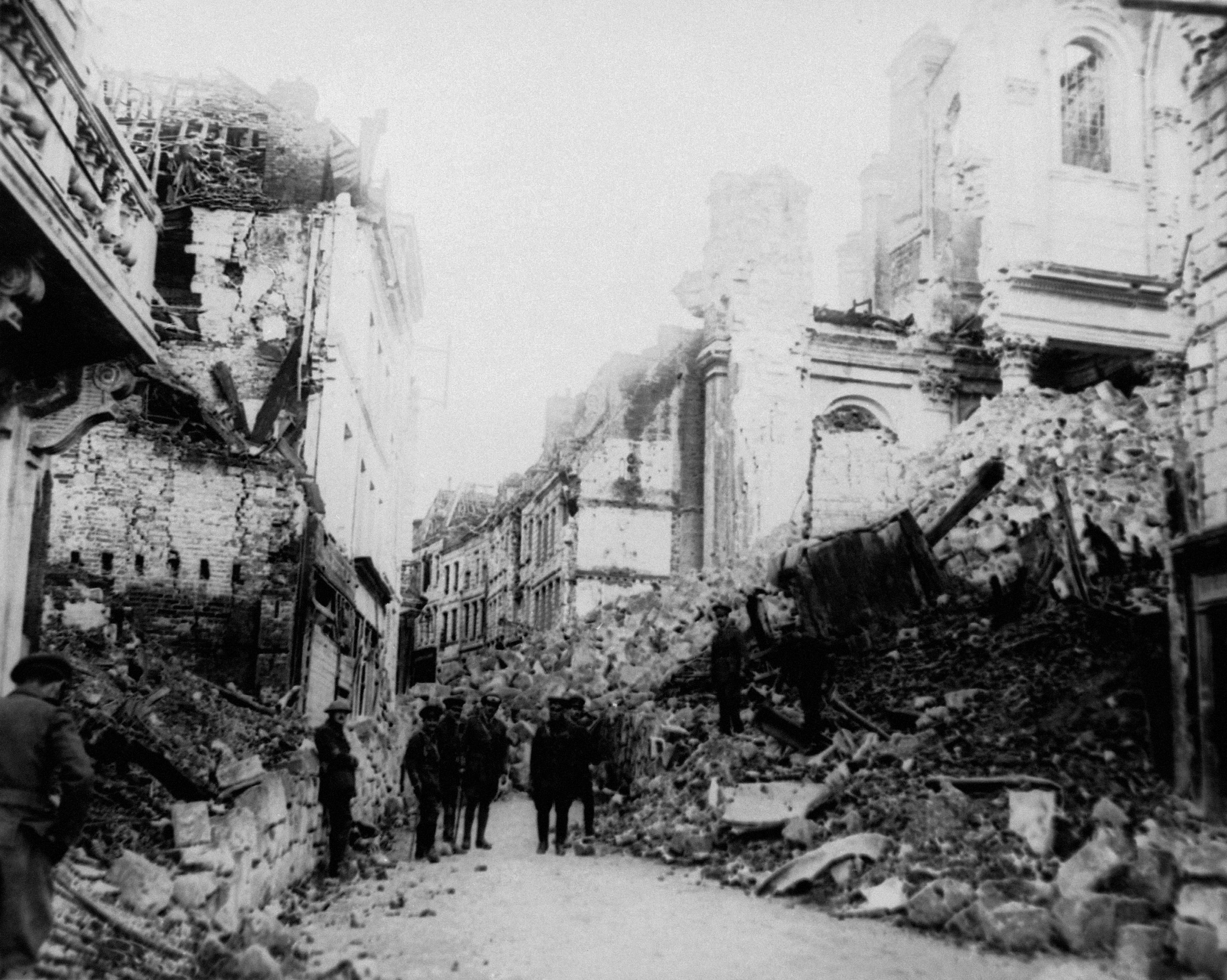 48 OF 100: In this August 1916 file photo, Gen. Sir Sam Hughes and an unidentified group look at ruins in Arras, France during World War I.