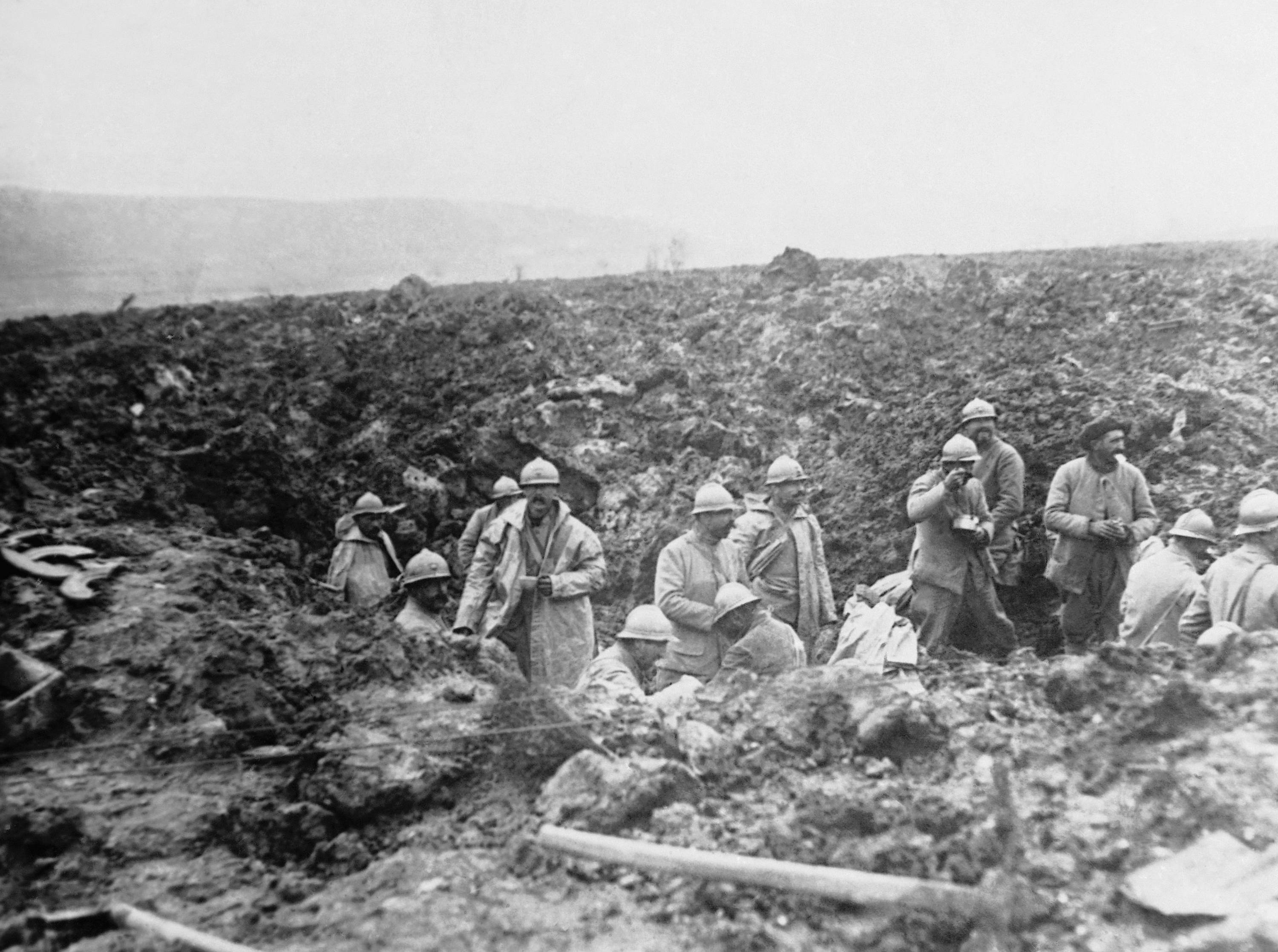 49 OF 100: In this October 1917 file photo, French troops in a shell hole during the offensive, which resulted in its winning back of the Chemin des Dames in France at the end of October 1917.