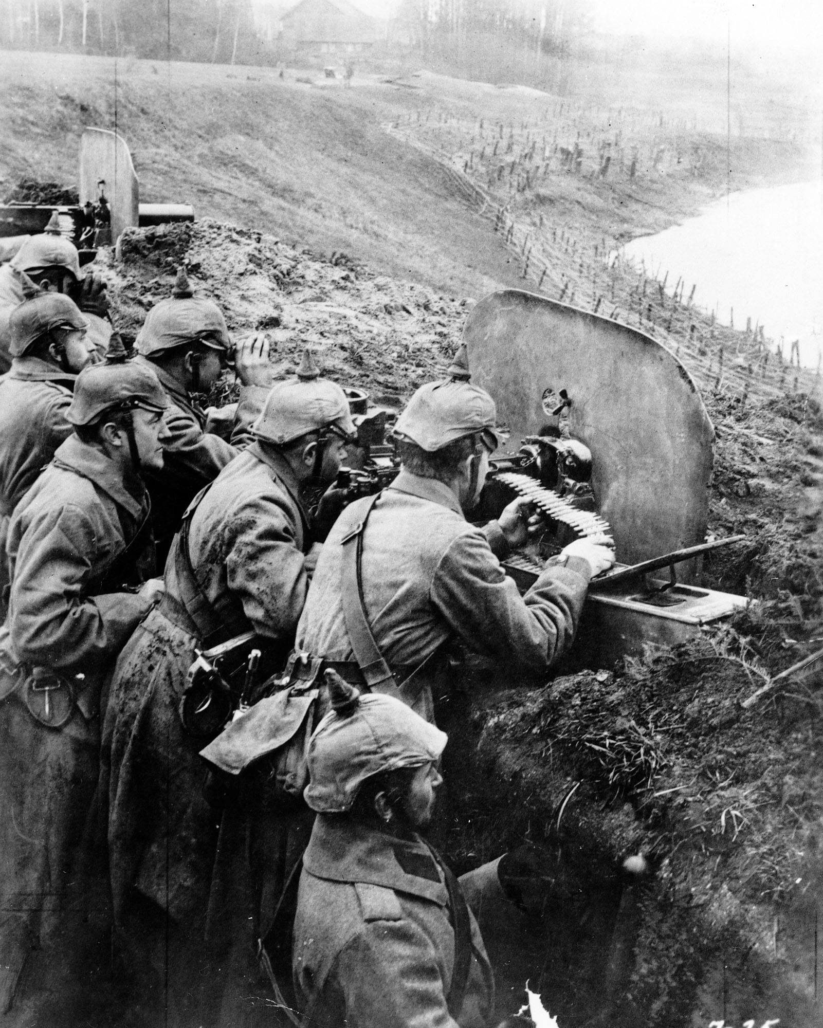 55 OF 100: In this 1916 file photo, German troops man a machine gun post from a trench at the Vistula River in Russia during World War I.