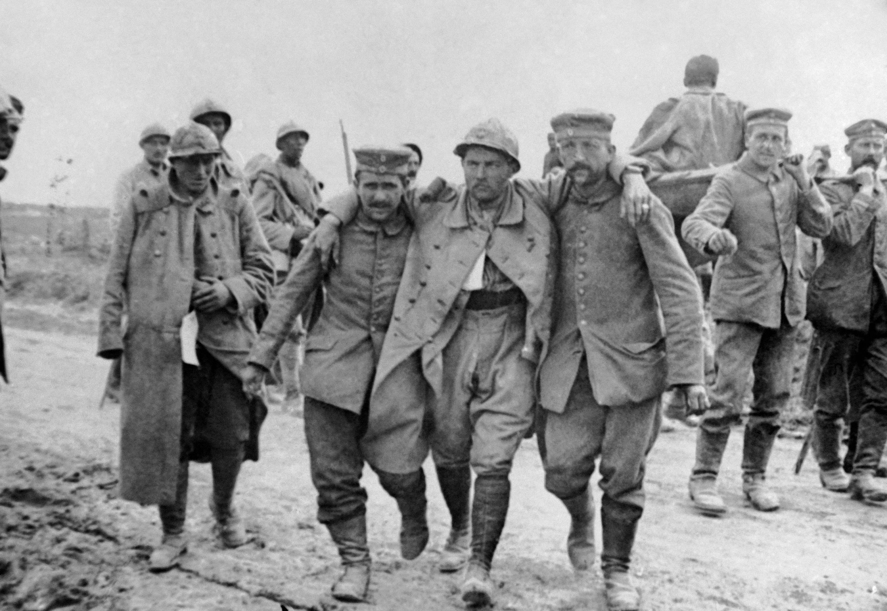 57 OF 100: In this undated file photo, French soldiers carry the wounded during the World War I Battle of the Somme, France.