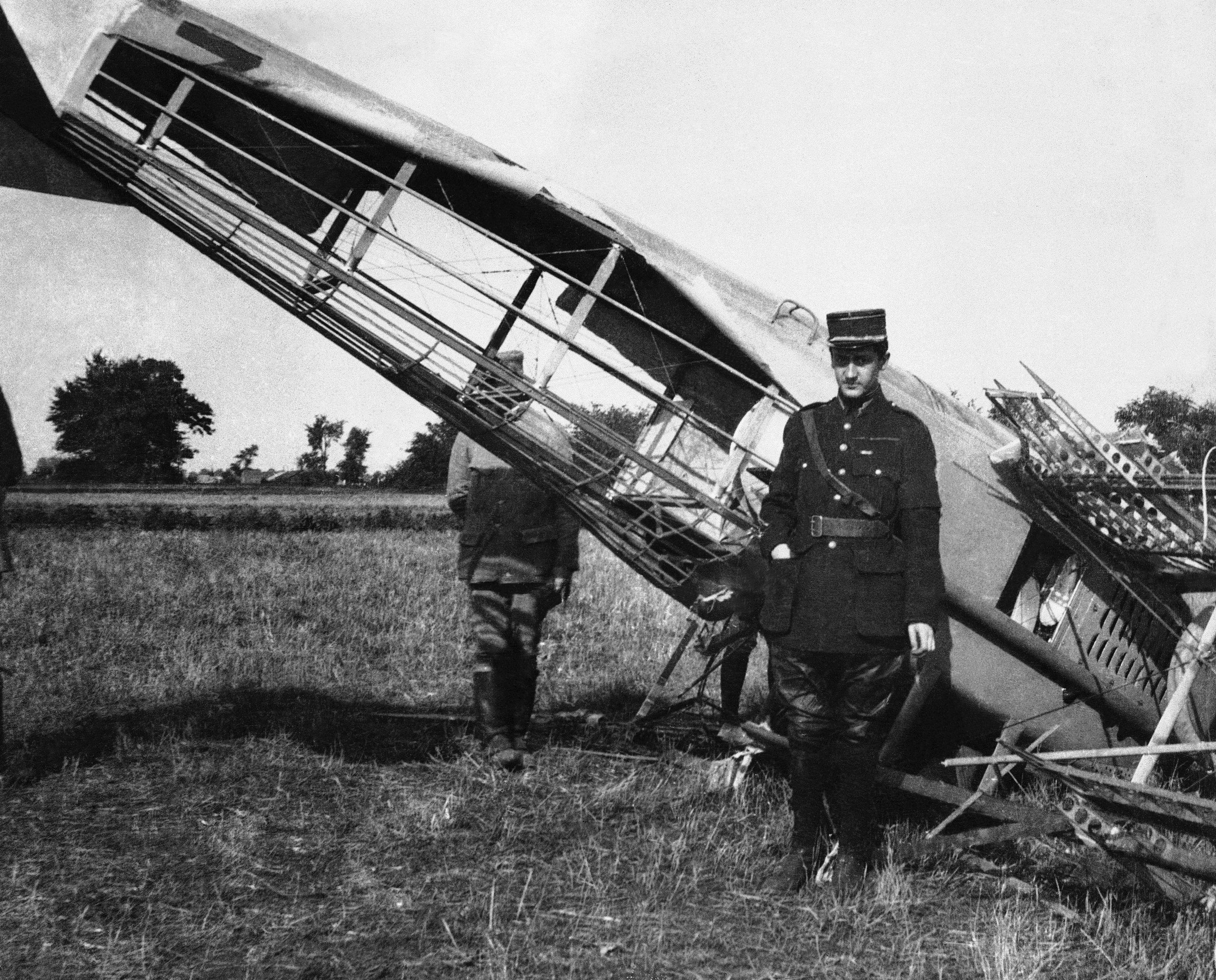 58 OF 100: In this Sept. 24, 1916 file photo, French Capt. Georges Guynemer in front of his shot-down plane in Piennes, France, during World War I.