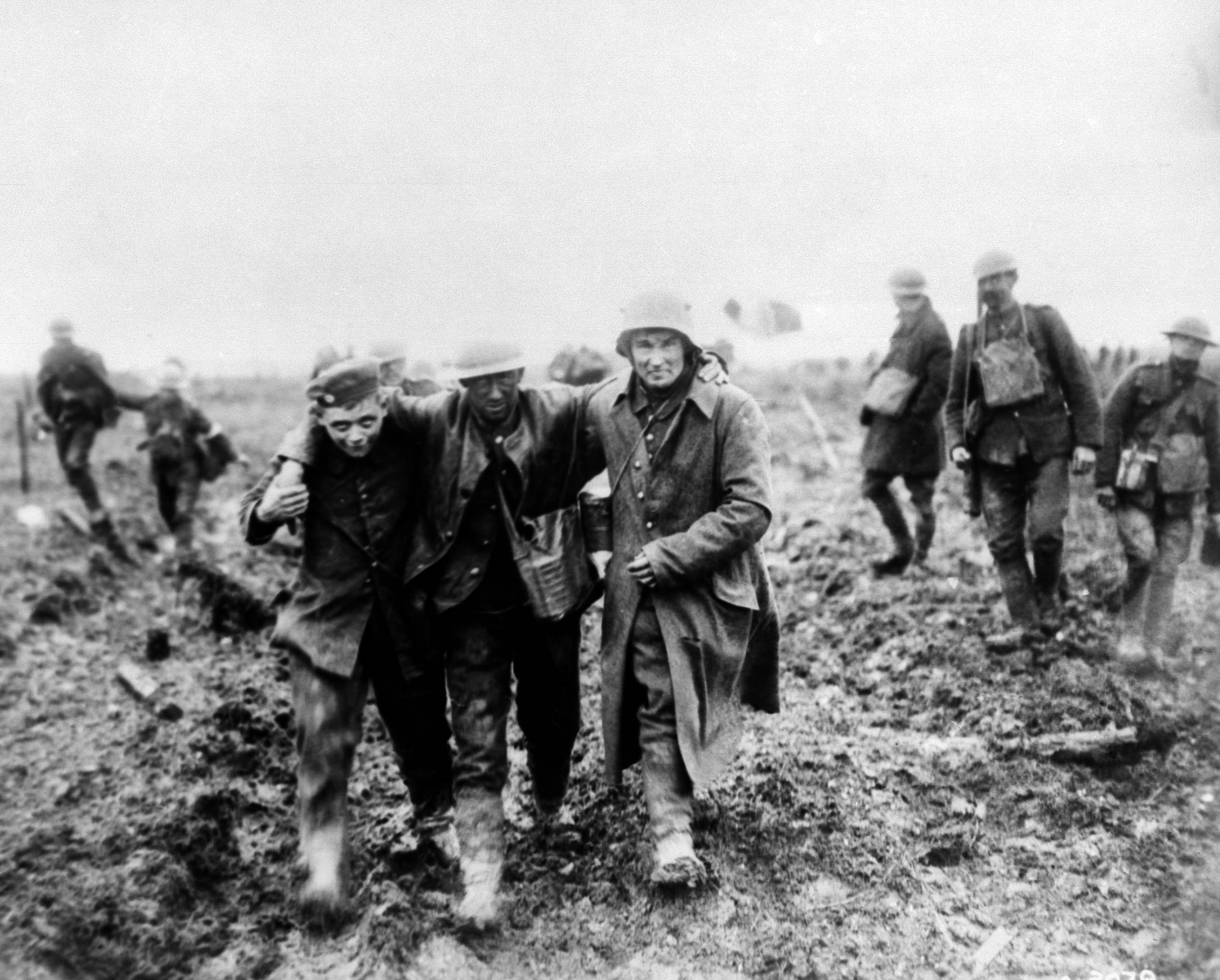 61 OF 100: In this 1917 file photo, German soldiers bring in Canadian wounded during the Battle of Vimy, France, during World War I.