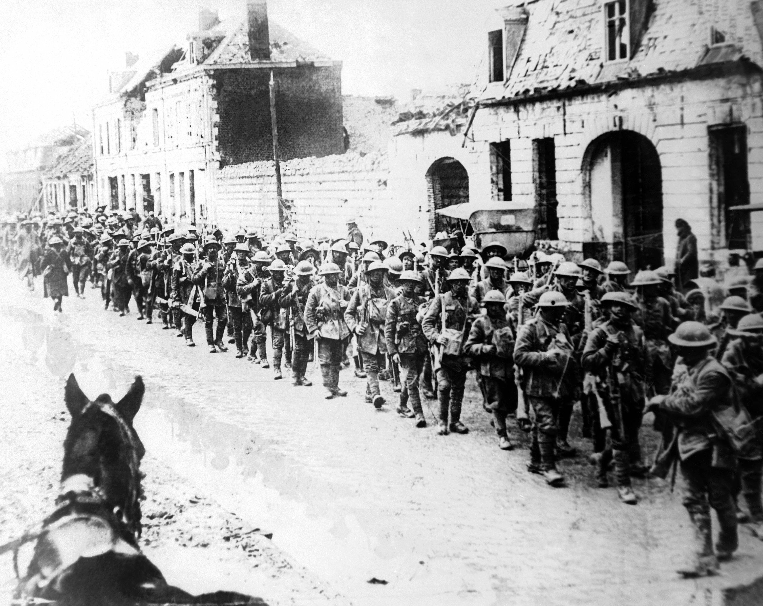 66 OF 100: In this 1917 file photo, British World War I soldiers return in formation to Ypres, Belgium.