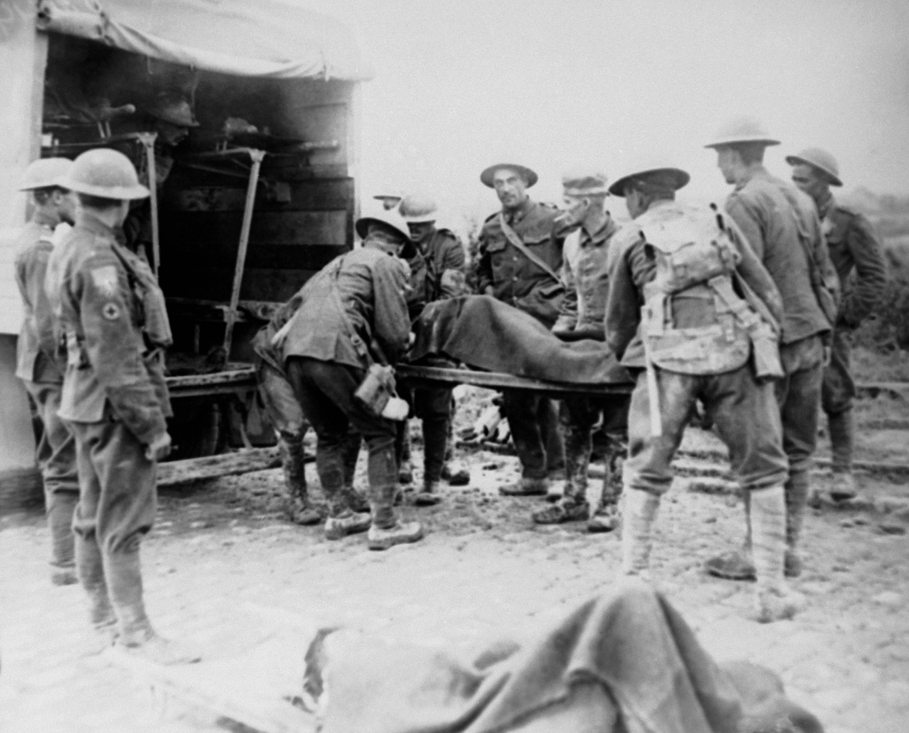 69 OF 100: In this undated file photo, World War I wounded are being placed in ambulance during the advance on Lens, France.