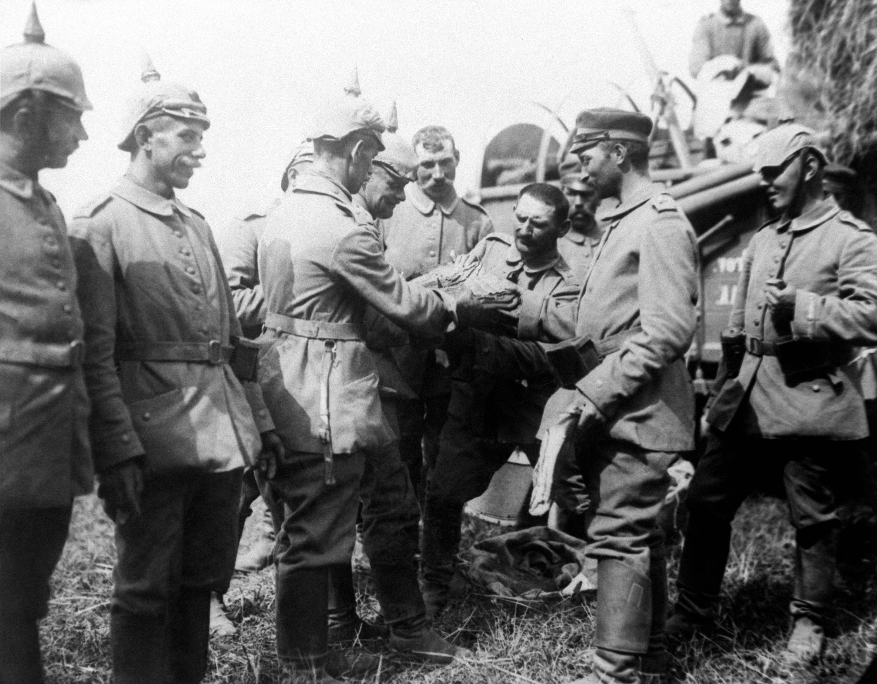 EIGHT OF 100: In this 1914 file photo, German army troops receive rations from a field transport while advancing toward Brussels. In mid-August 1914 the German army launched its assault on Brussels.