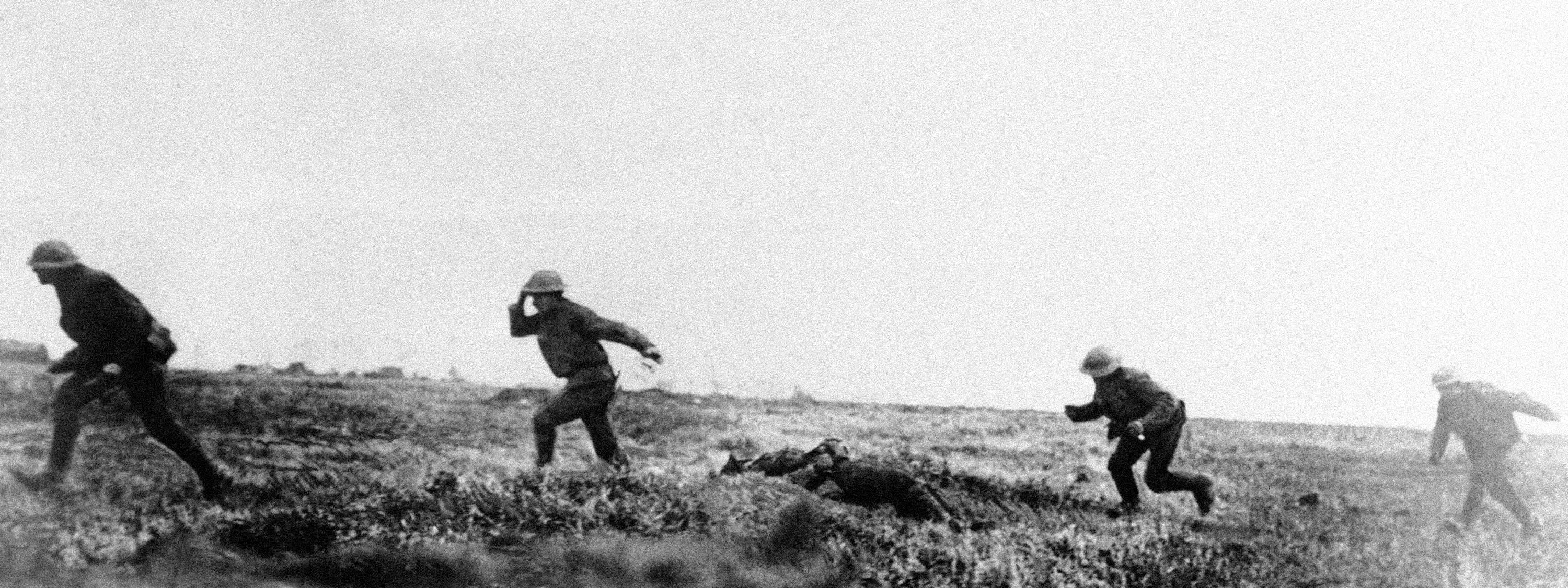 72 OF 100: In this undated file photo, British troops run under heavy fire outside Cambrai, France, during World War I.